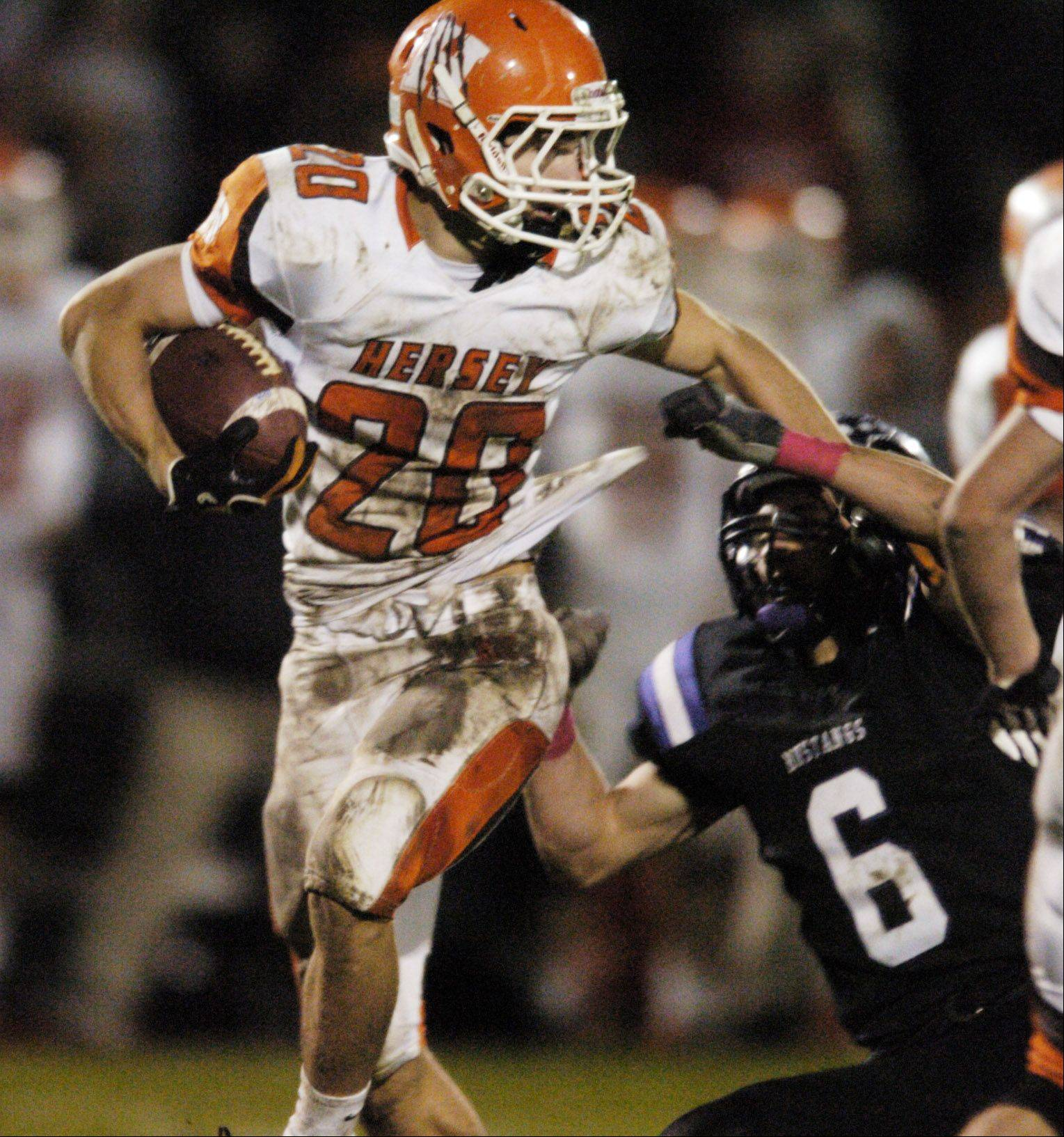 Week 9- Hersey's Frank Kalble tries to get past Rolling Meadows' Derek Heer.