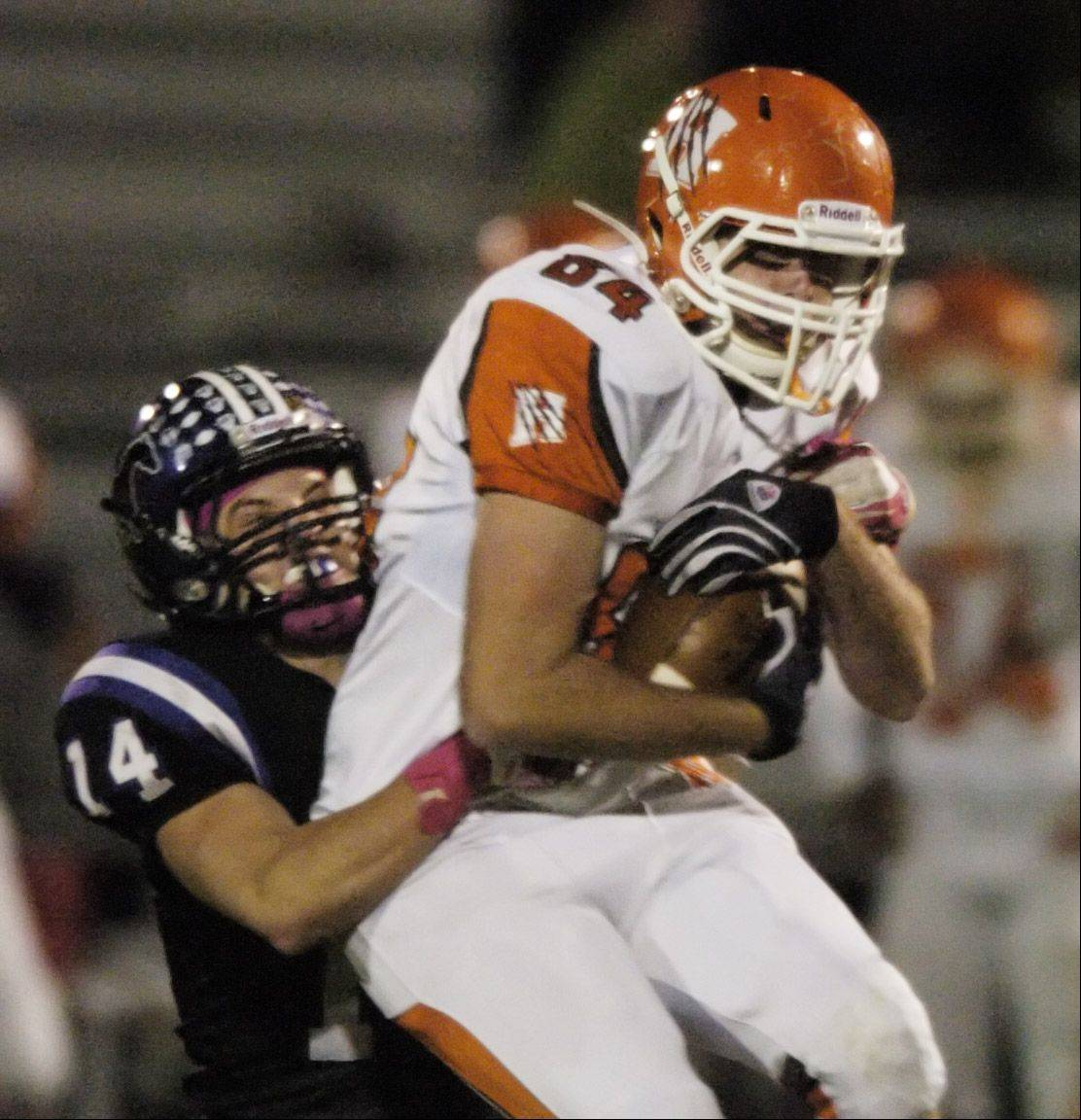 Week 9- Hersey's Justin Jobski catches a pass but is immediately tackled by Rolling Meadows' Artie Checchin.
