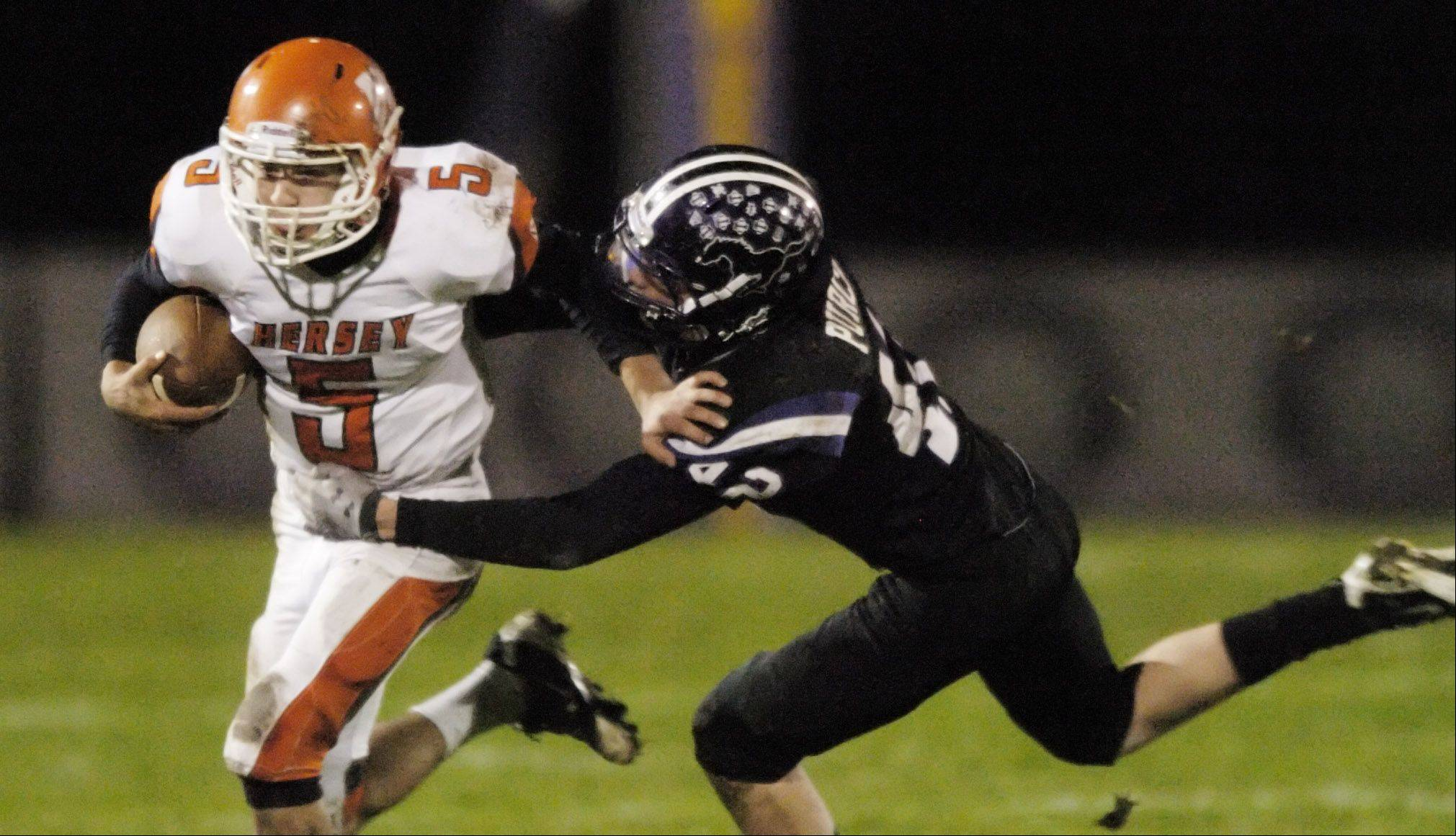 Week 9- Hersey quarterback Brad Zaucha is tackled by Rolling Meadows' Scott Purcell.