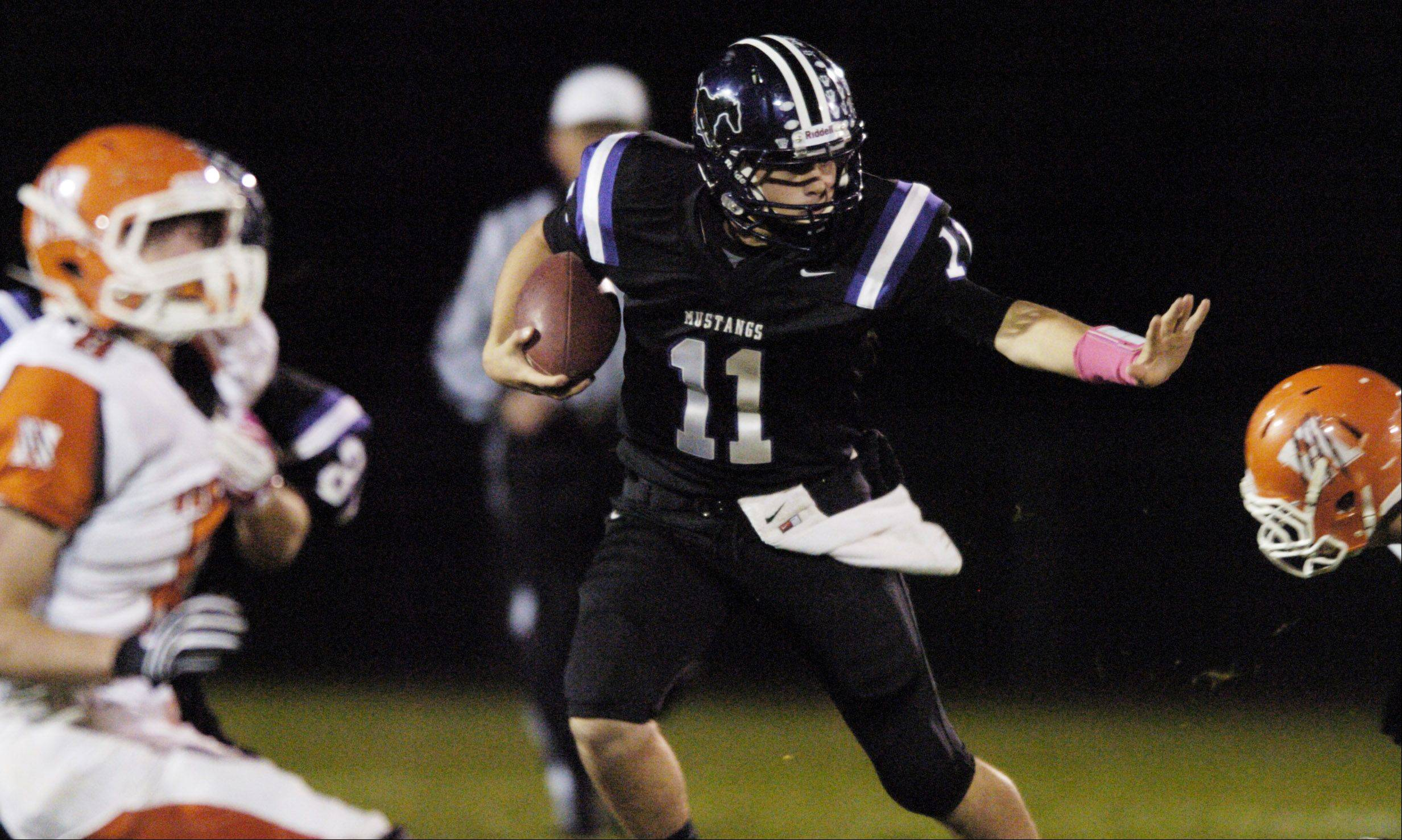 Week 9- Jack Milas of Rolling Meadows carries the ball against Hersey.