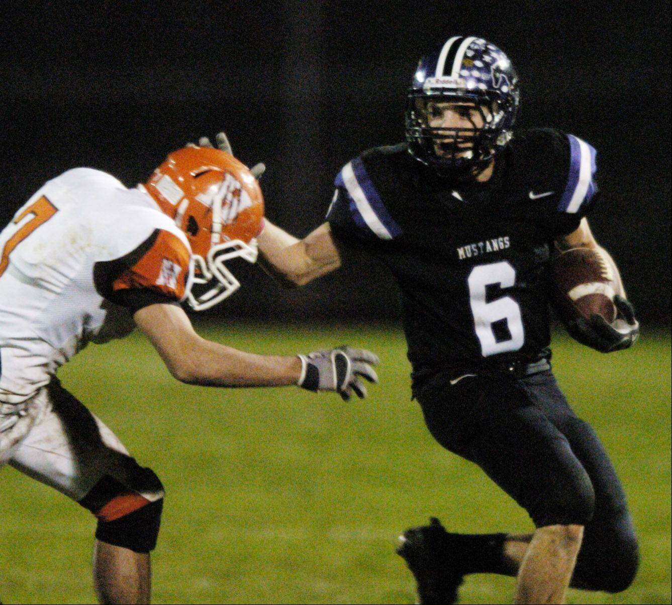 Week 9- Derek Heer of Rolling Meadows tries to get past Joe Rodgers of Hersey.
