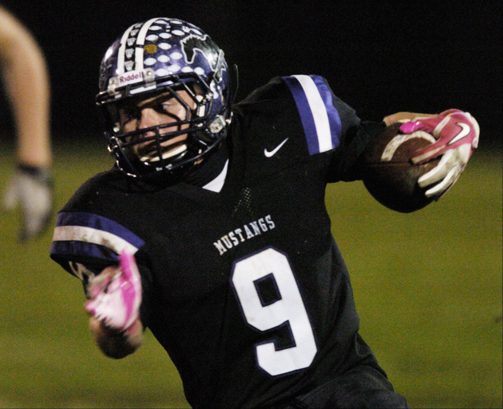 Week 9- Garrett Peterson of Rolling Meadows carries the ball against Hersey.