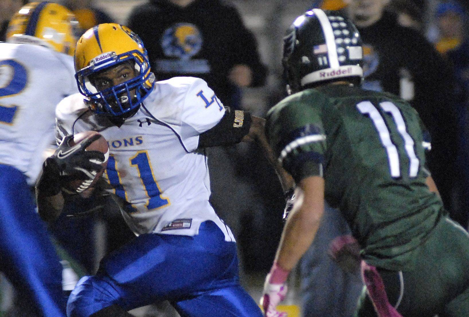 Lyons Township's Matthew Harris zips past Bartlett's Kyle Garcia to score the game-winning touchdown in Lyons' 45-42 come-from-behind win over the Hawks in the Class 8A playoffs at Millennium Field in Streamwood Saturday night.