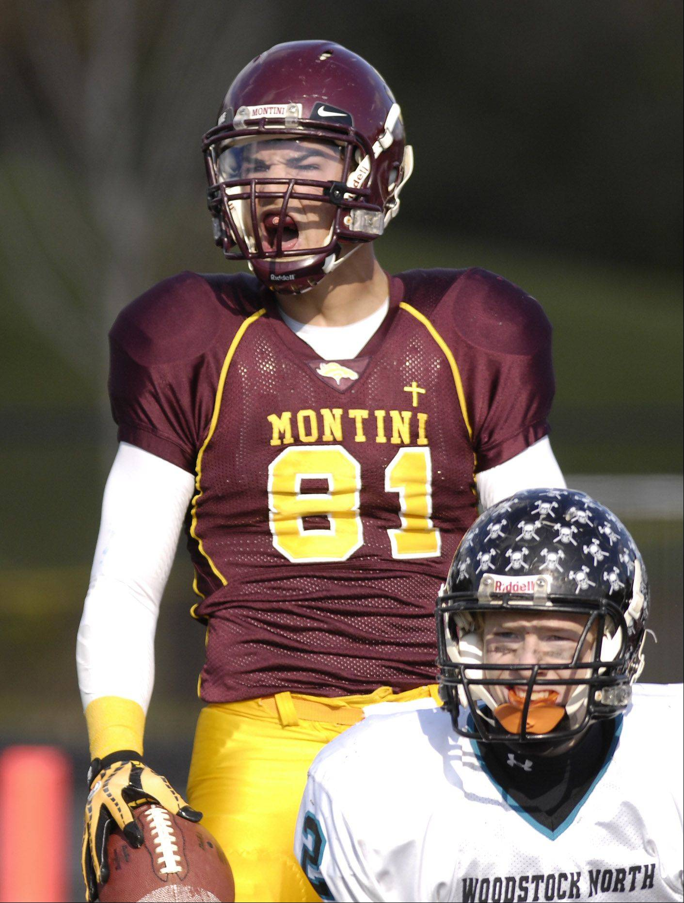 Jordan Westerkamp of Montini celebrates a long drive with in yard of the goal line, during IHSA 5A playoff game against Woodstock North High School at home in Lombard.