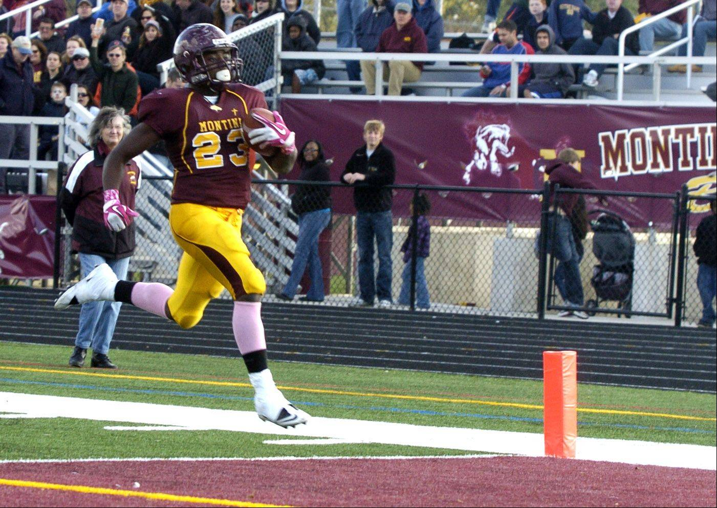 Dimitri Taylor of Montini High School scores a 4th quarter touchdown, during the IHSA 5A playoff game.