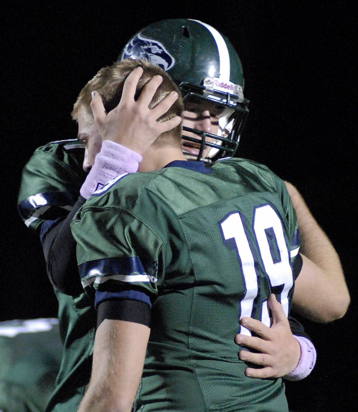 Bartlett's Kyle Pauletti, left, comforts teammate Ian Dobek after their loss to Lyons Township.