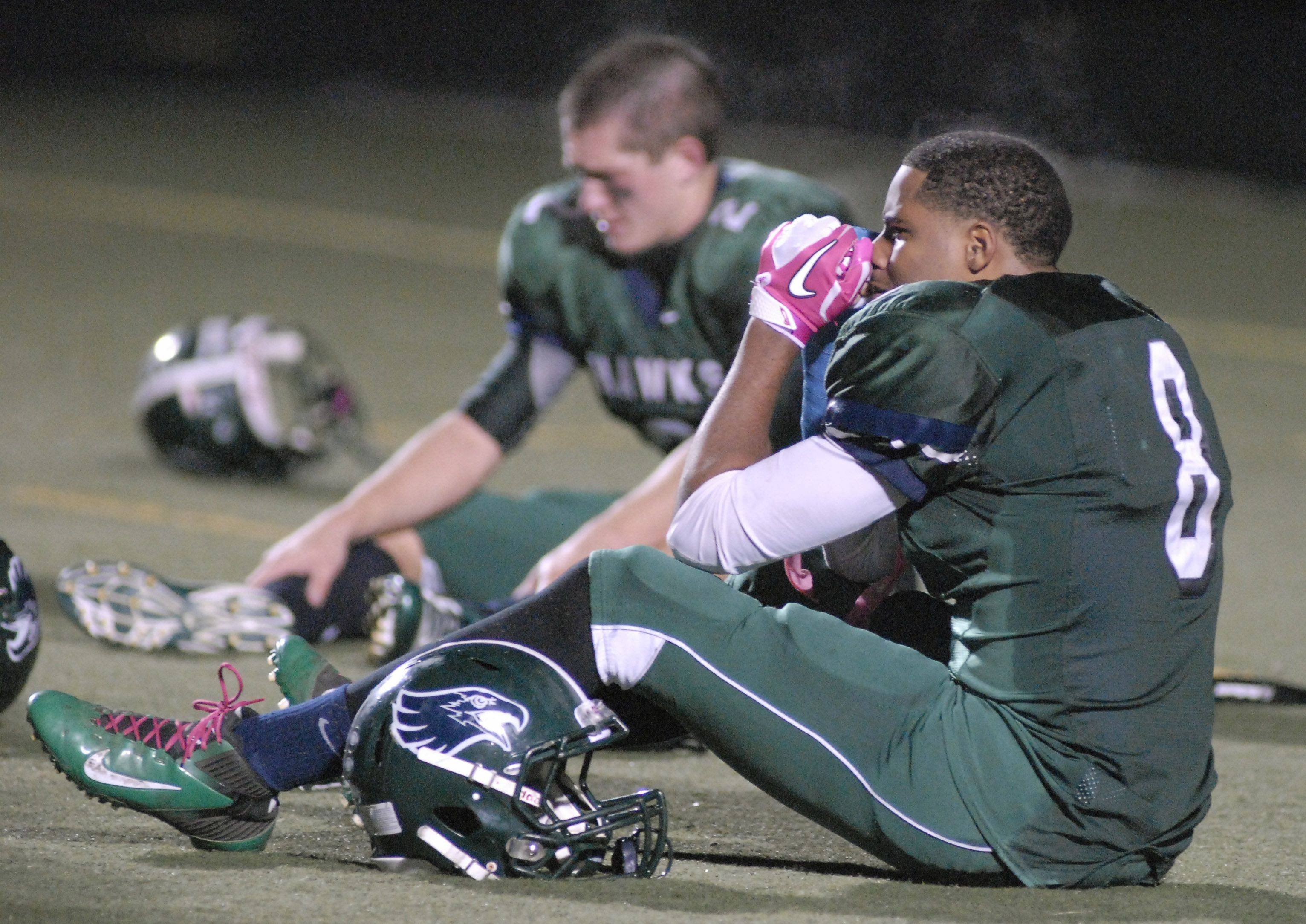 Bartlett's Demetrius Coleman (8) and Zach Karys gather their emotions after losing to Lyons Township.