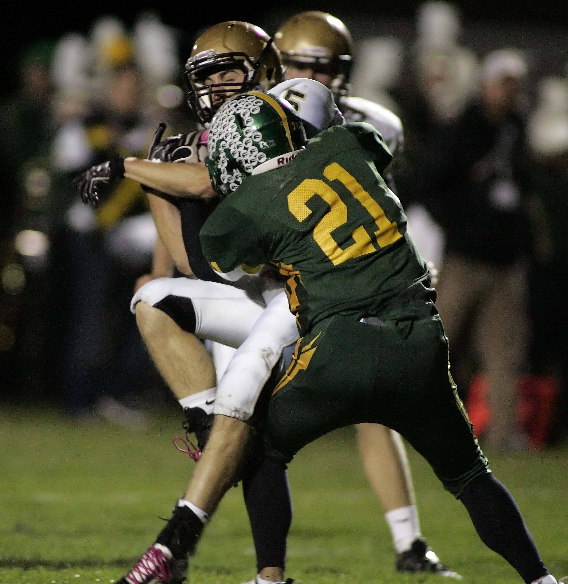Crystal Lake South senior Brad Walovitch (21) has been a mainstay on offense and defense for the 9-1 Gators this season.