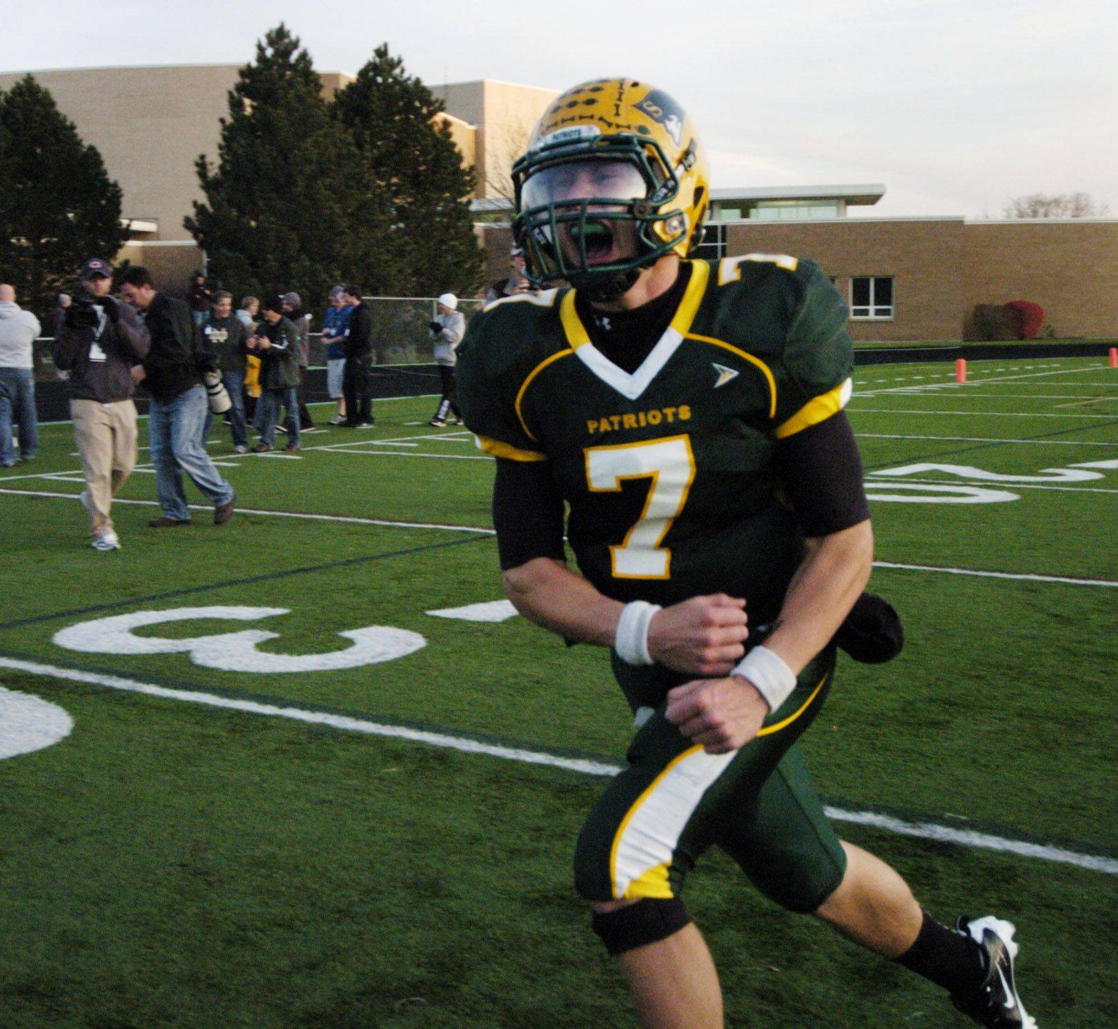 Stevenson quarterback Matt Micucci celebrates after the Patriots defeated Maine South during Saturday's class 8A playoff game.