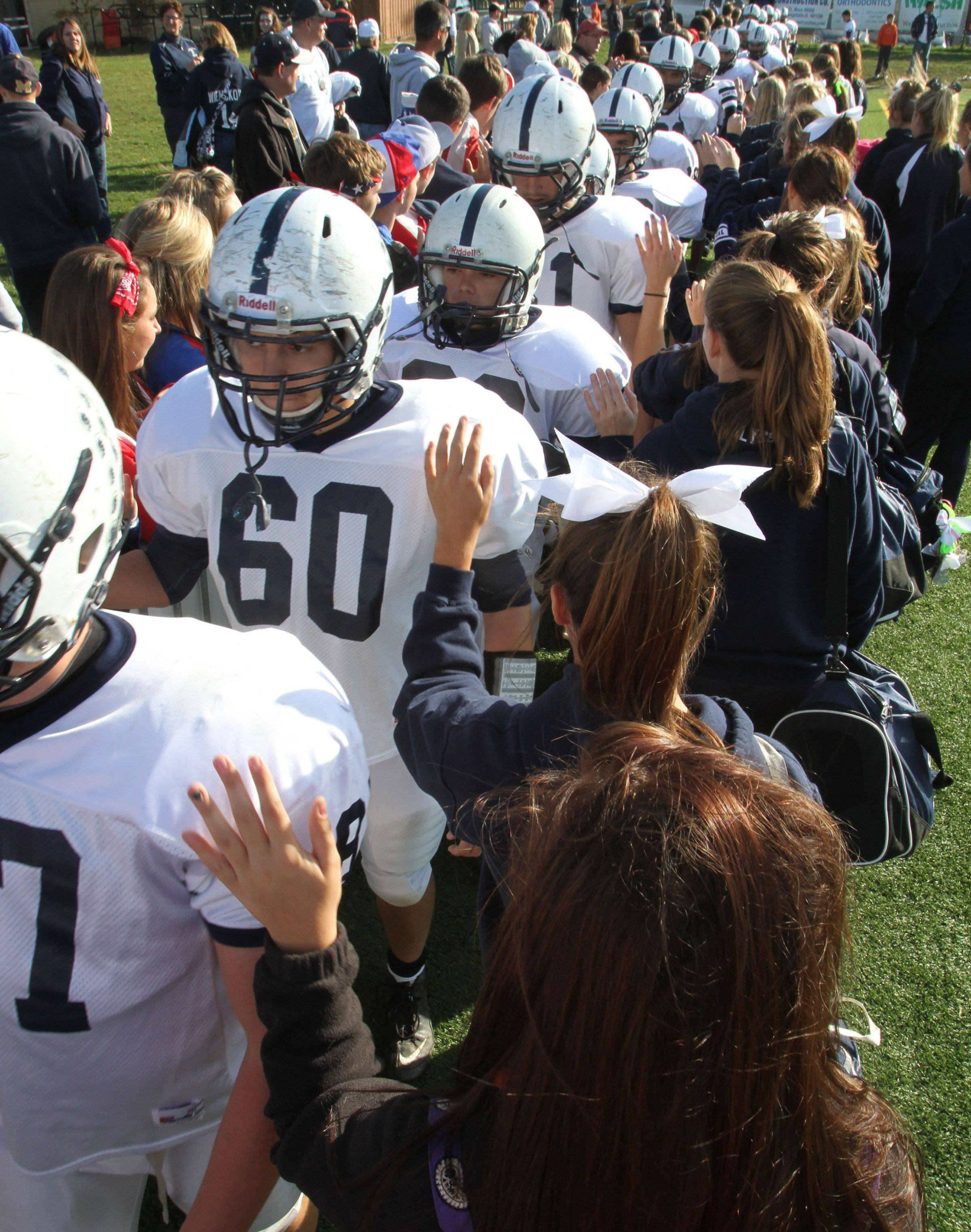 Cary-Grove receives a hand from student fans as they leave the field after losing to Nazareth Academy in LaGrange Park on Saturday, November 5th.