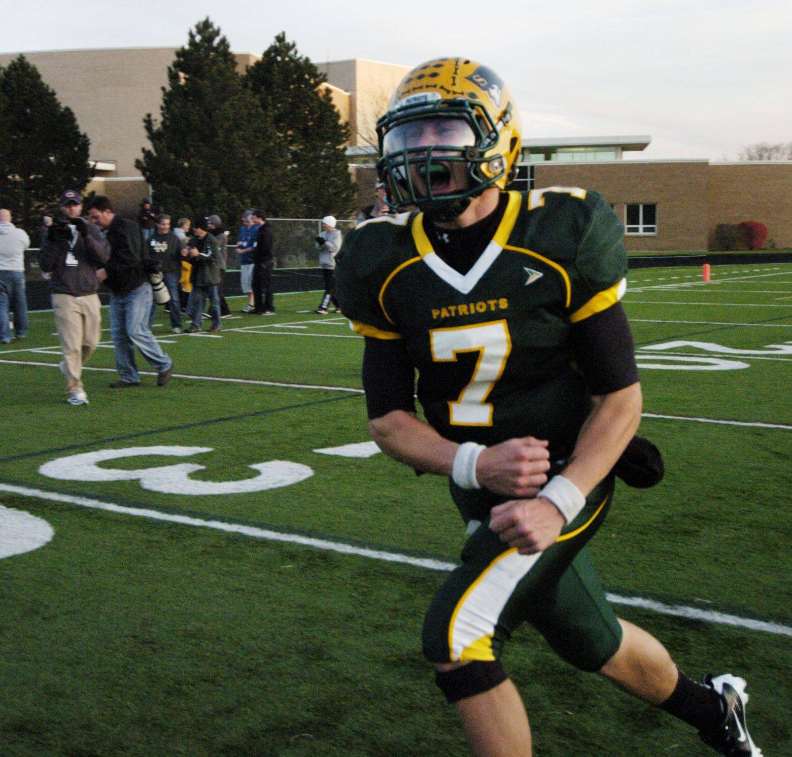 Stevenson quarterback Matt Micucci celebrates after the Patriots defeated visiting Maine South in Saturday's Class 8A playoff game.