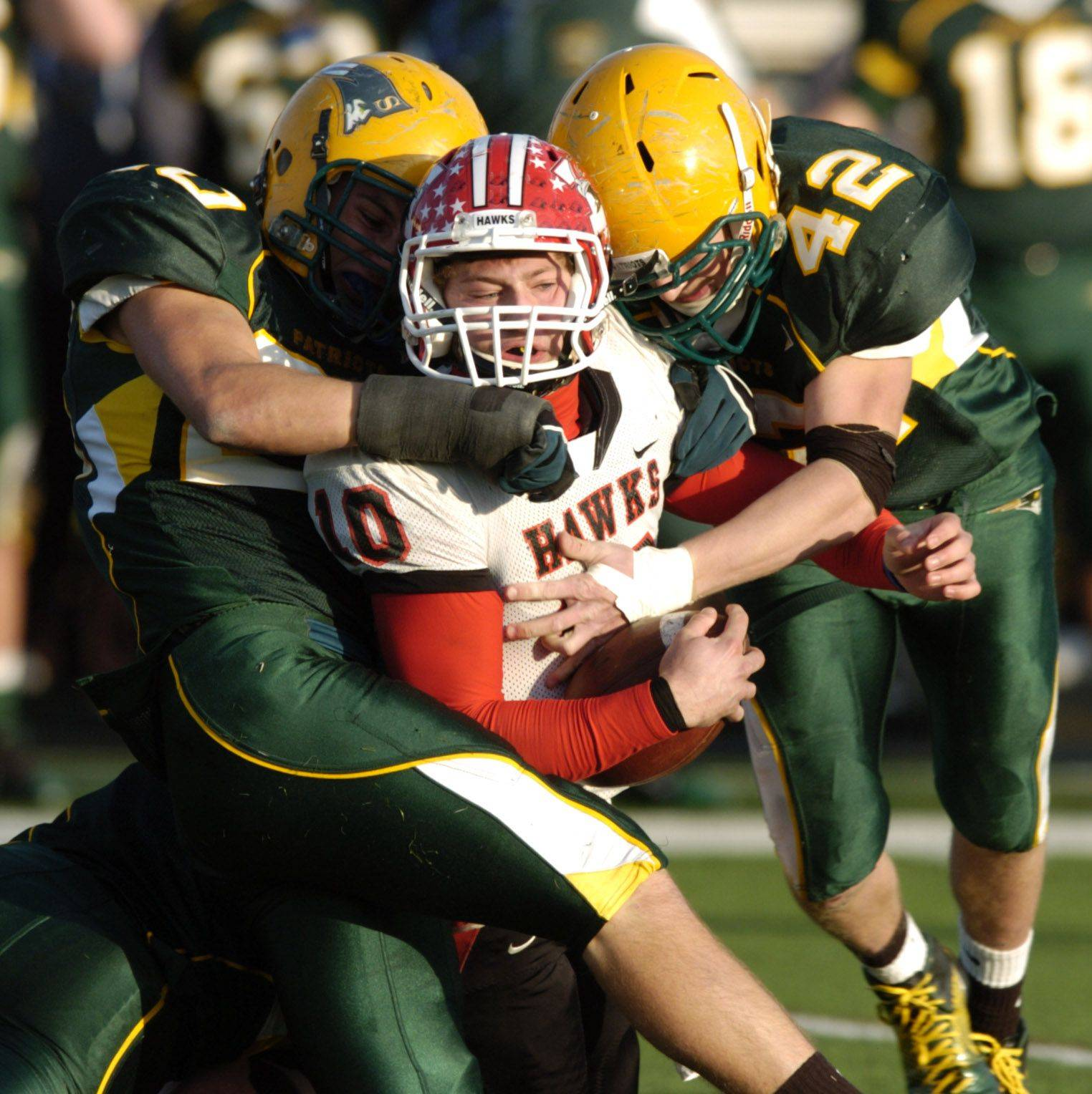 Maine South quarterback Matt Alviti is hit hard by Stevenson's Carl Miller, left, and Quentin Lorenzo Saturday.