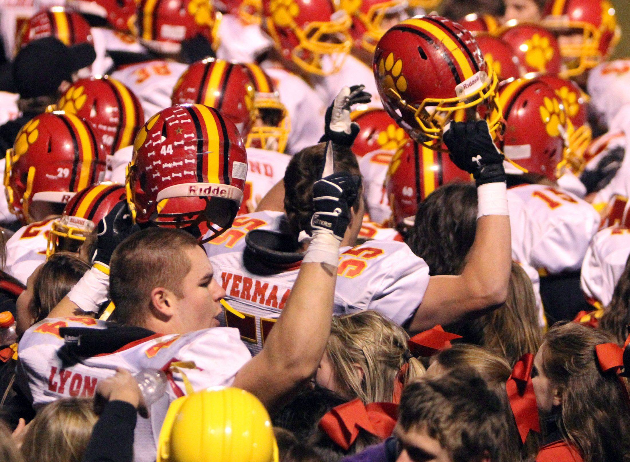 Batavia celebrates 42-0 win over Lakes at Lakes on Saturday.