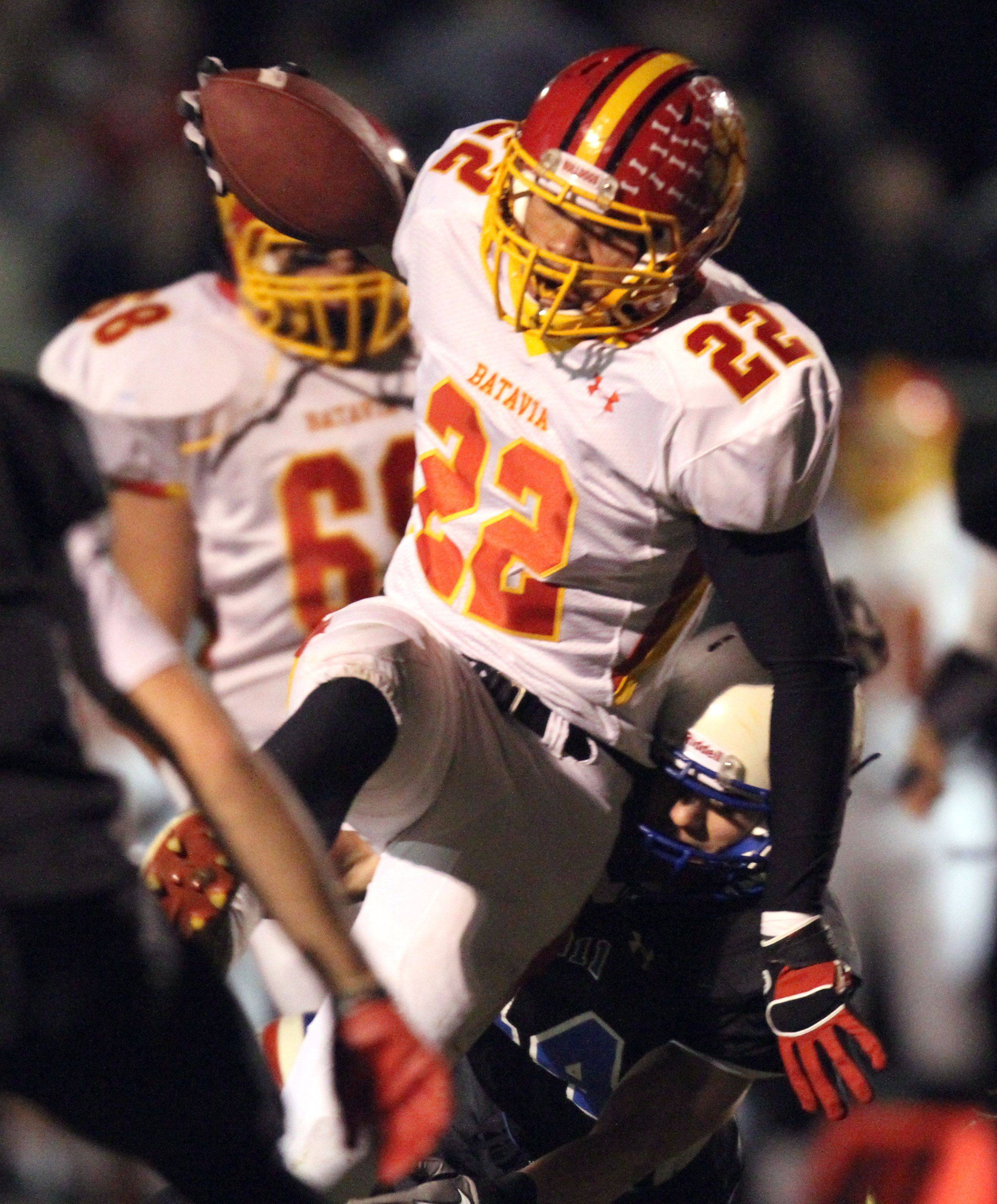 Batavia running back Anthony Thielk leaps over Lakes defenders during the first half at Lakes on Saturday, November 12th.