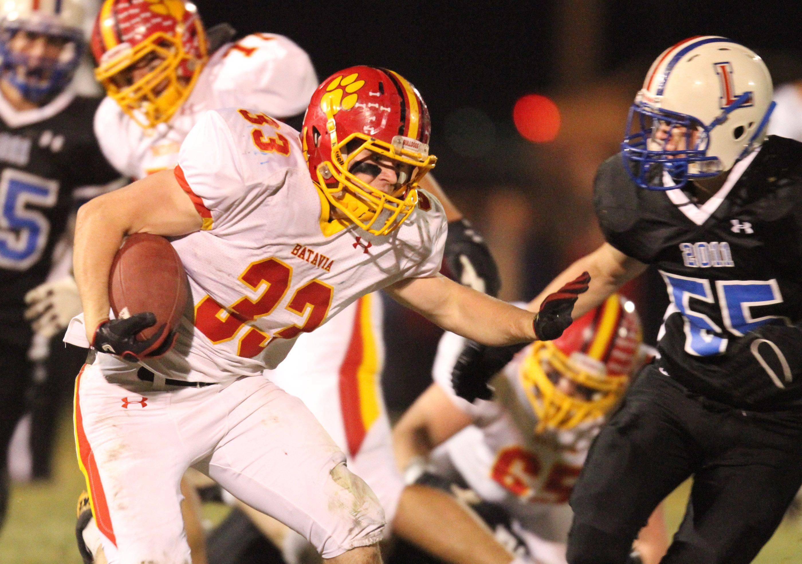 Batavia's Dom Guzaldo running the ball looks to dodge Lakes defender Alan Gomez during the first half at Lakes on Saturday, November 12.