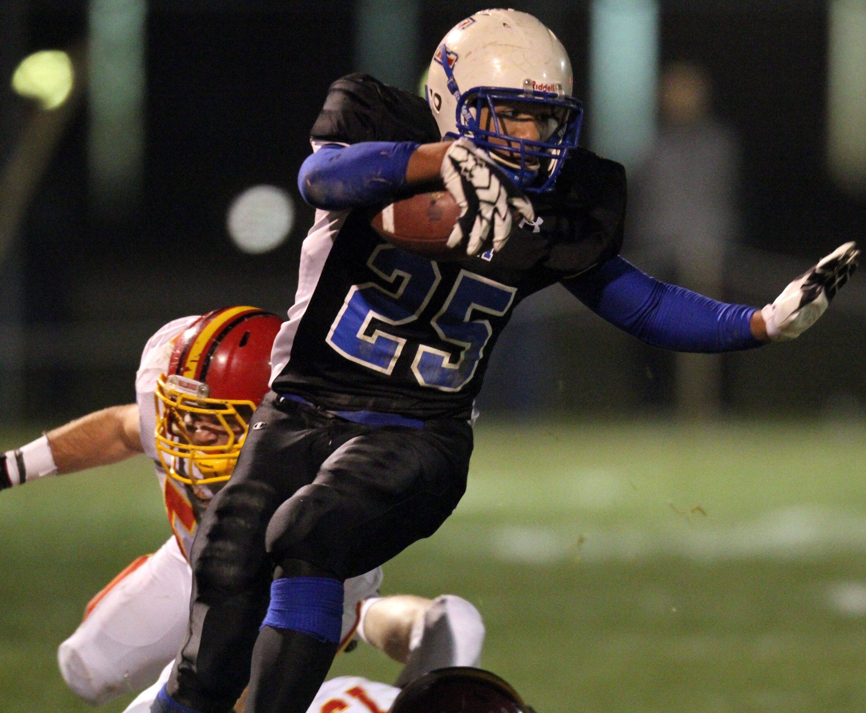 Lakes running back Direll Clark clears two Batavia defenders during the first half at Lakes on Saturday, November 12th.
