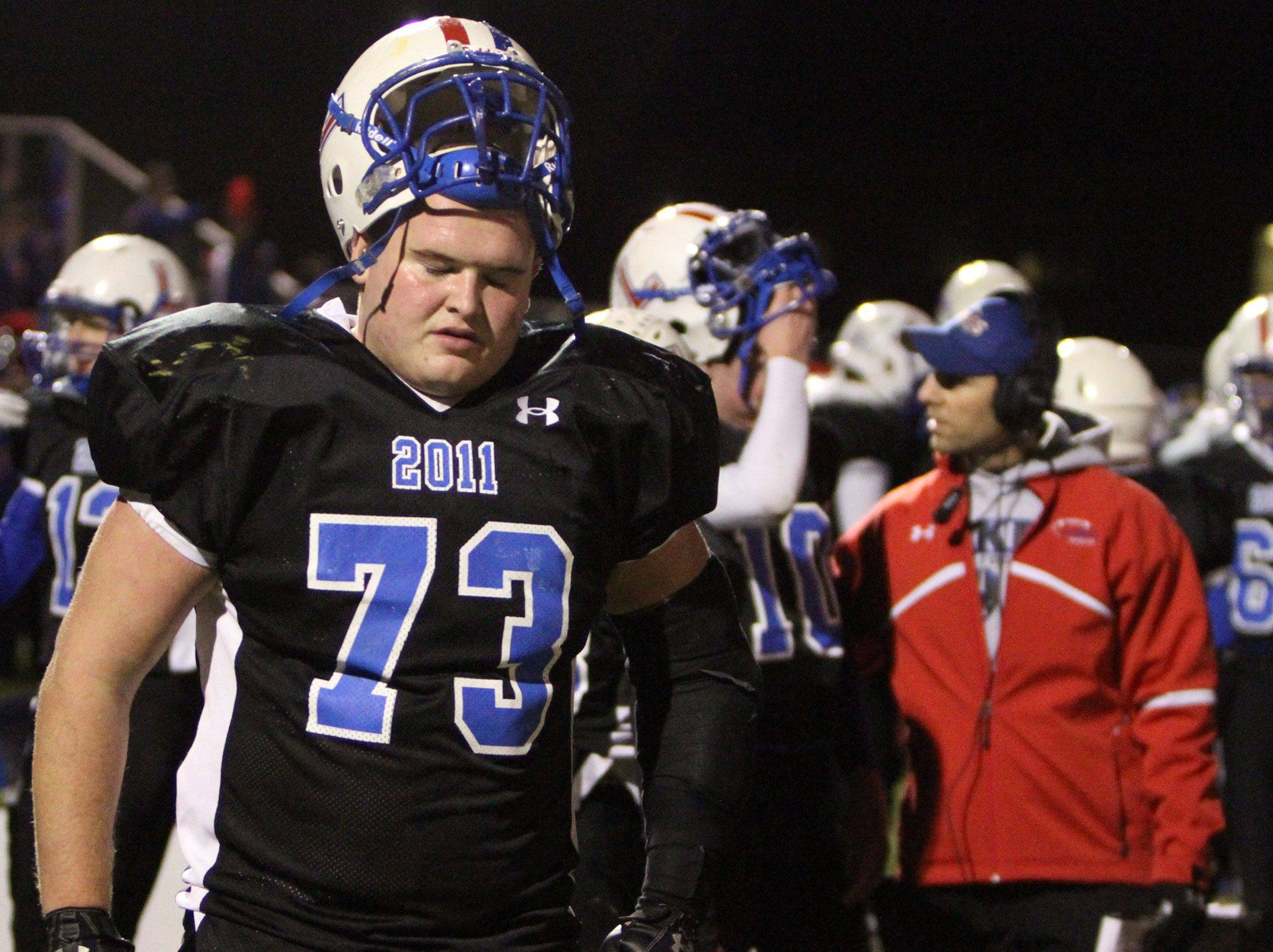 Lakes' offensive lineman Ty Summers walks along the sidelines with seconds left on the clock as Lakes lost 42-0 against Batavia 42-0 at Lakes on Saturday, November 12th.