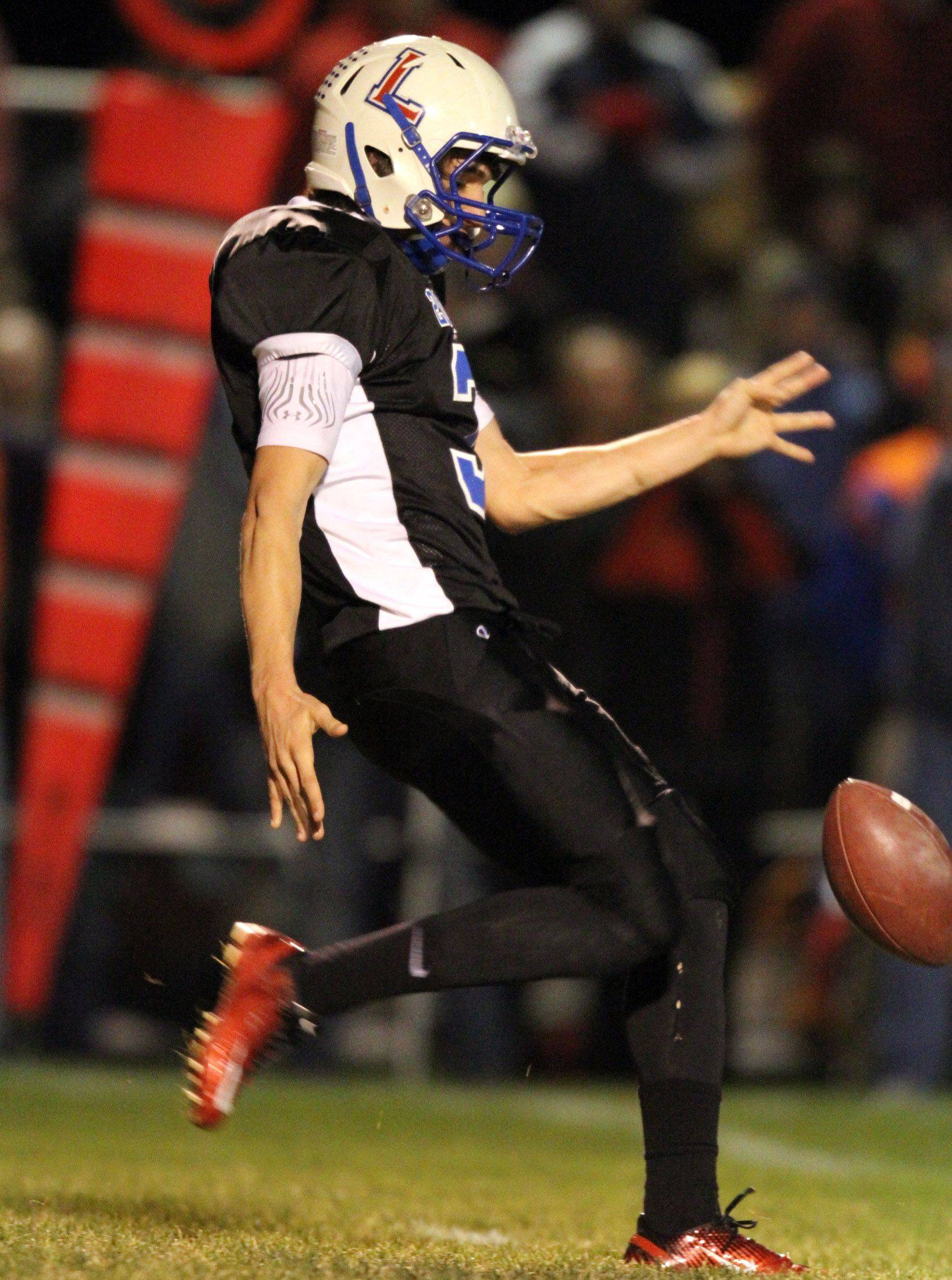 Lakes' Tanner Blain punts the ball away against Batavia at Lakes on Saturday, November 12th.