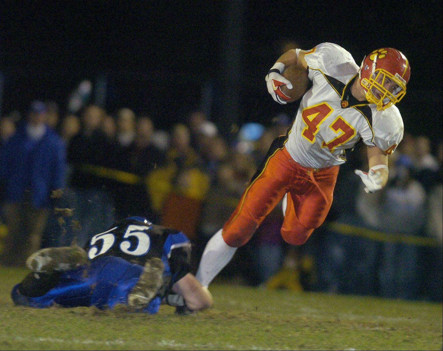 Brandon Holl, above, was a key part of Batavia's 2006 team that reached state, and Holl has returned this year to serve as a volunteer assistant coach on the 12-0 Bulldog squad that is one win away from returning to state.