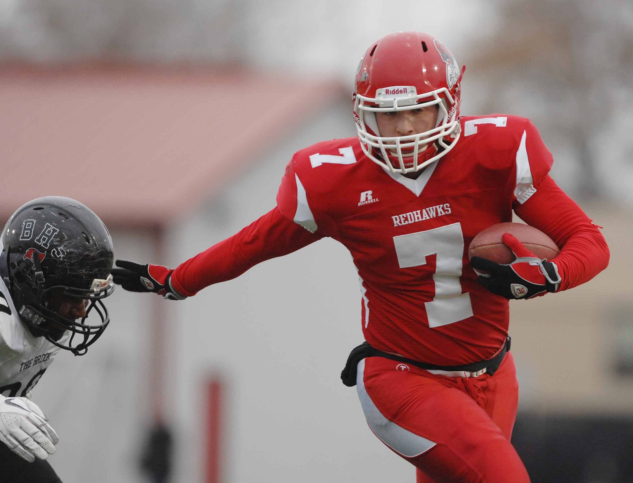 Ian Lewandowski of Naperville Central on the move during the Bolingbrook at Naperville Central football Class 8A semifinals Saturday.