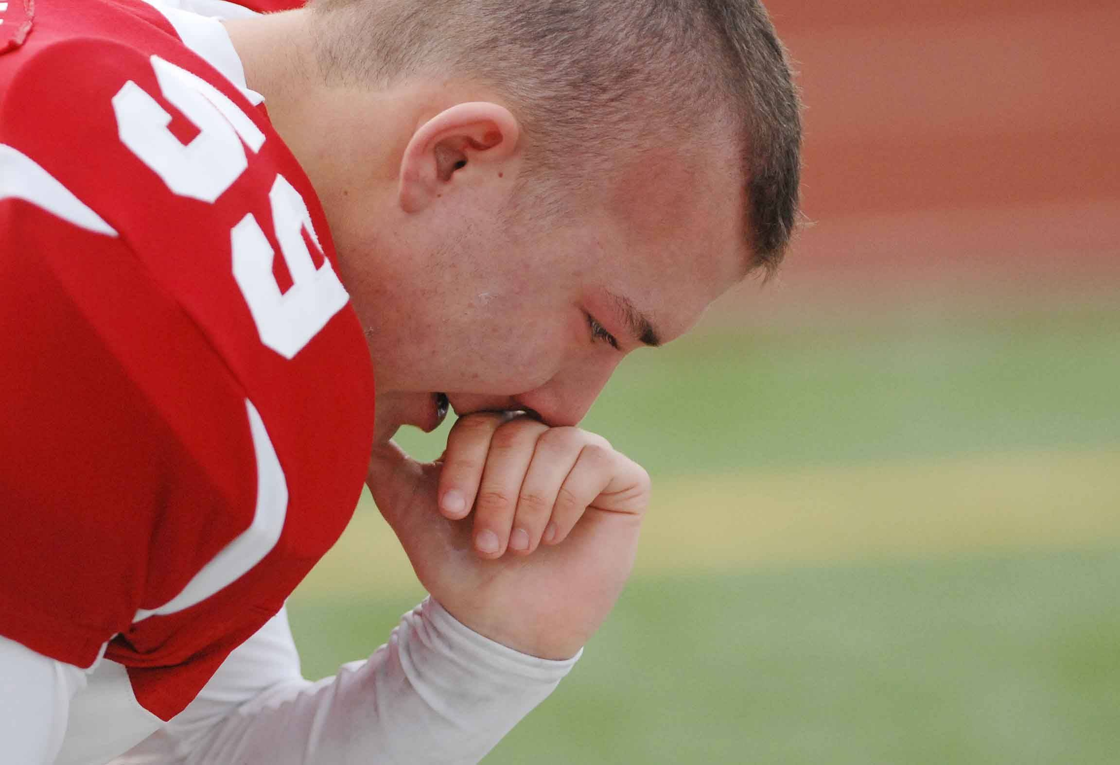 Tyler Gillen of Naperville Central sheds a tear after the big loss. This took place during the Bolingbrook at Naperville Central football Class 8A semifinals Saturday.