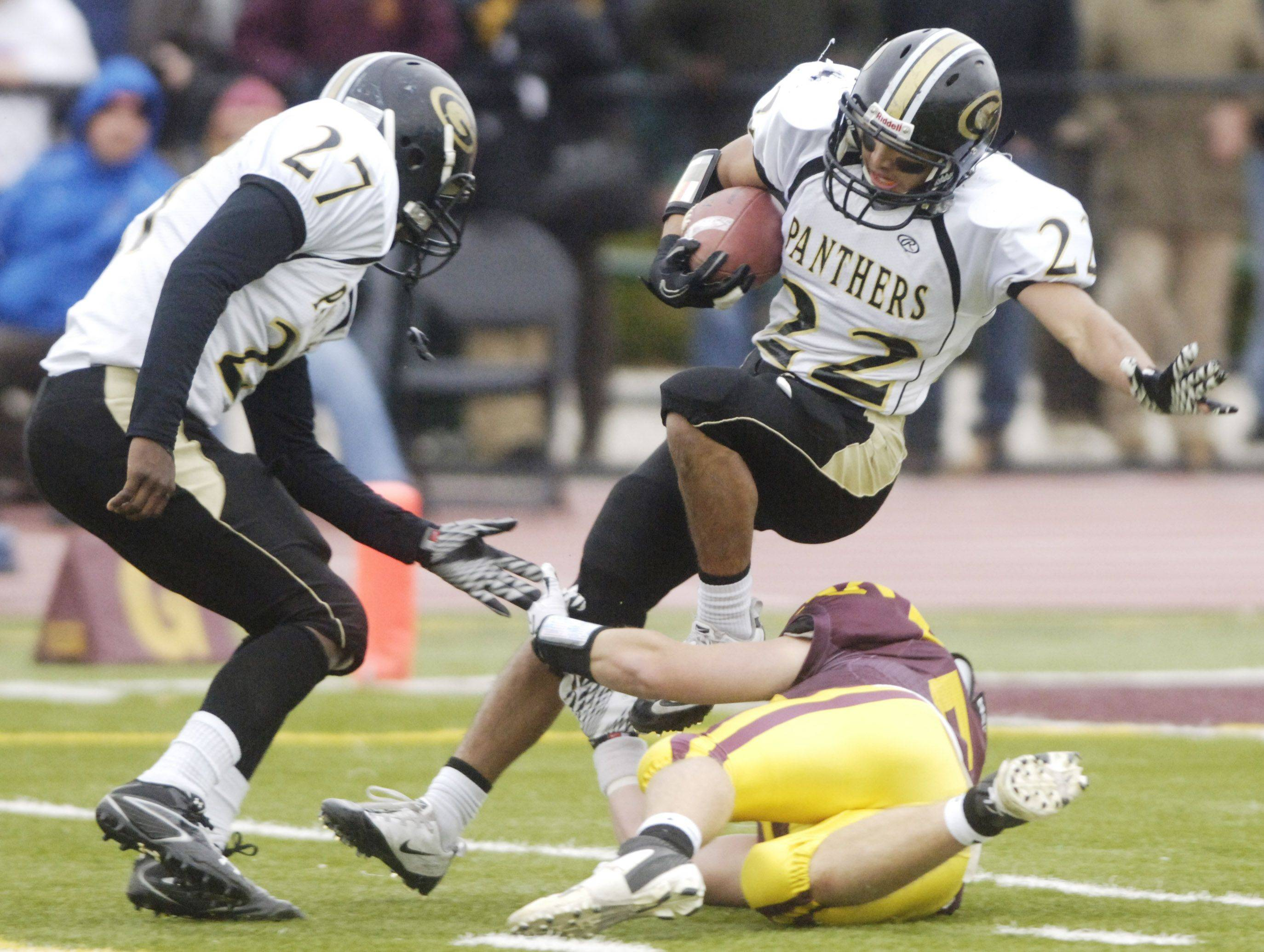 Glenbard North's Mario Rodriguez is tackled during Saturday's loss to Loyola Academy. Kendall Holbert of Glenbard North is the player at left.