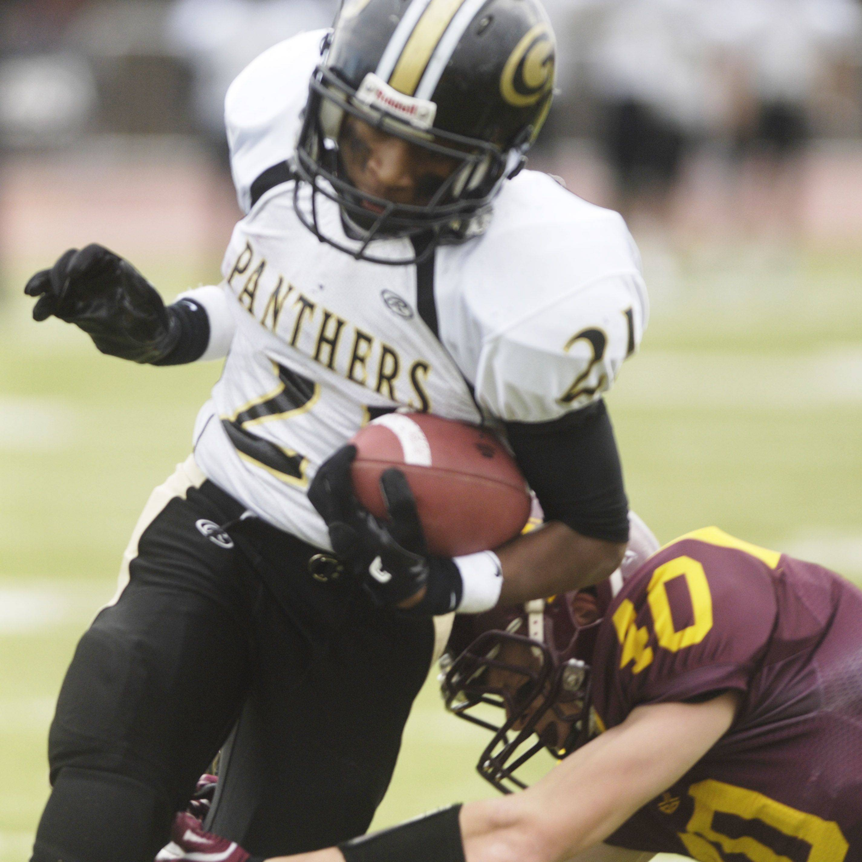 Justin Jackson of Glenbard North gets tackled by Luke Ford of Loyola Academy.