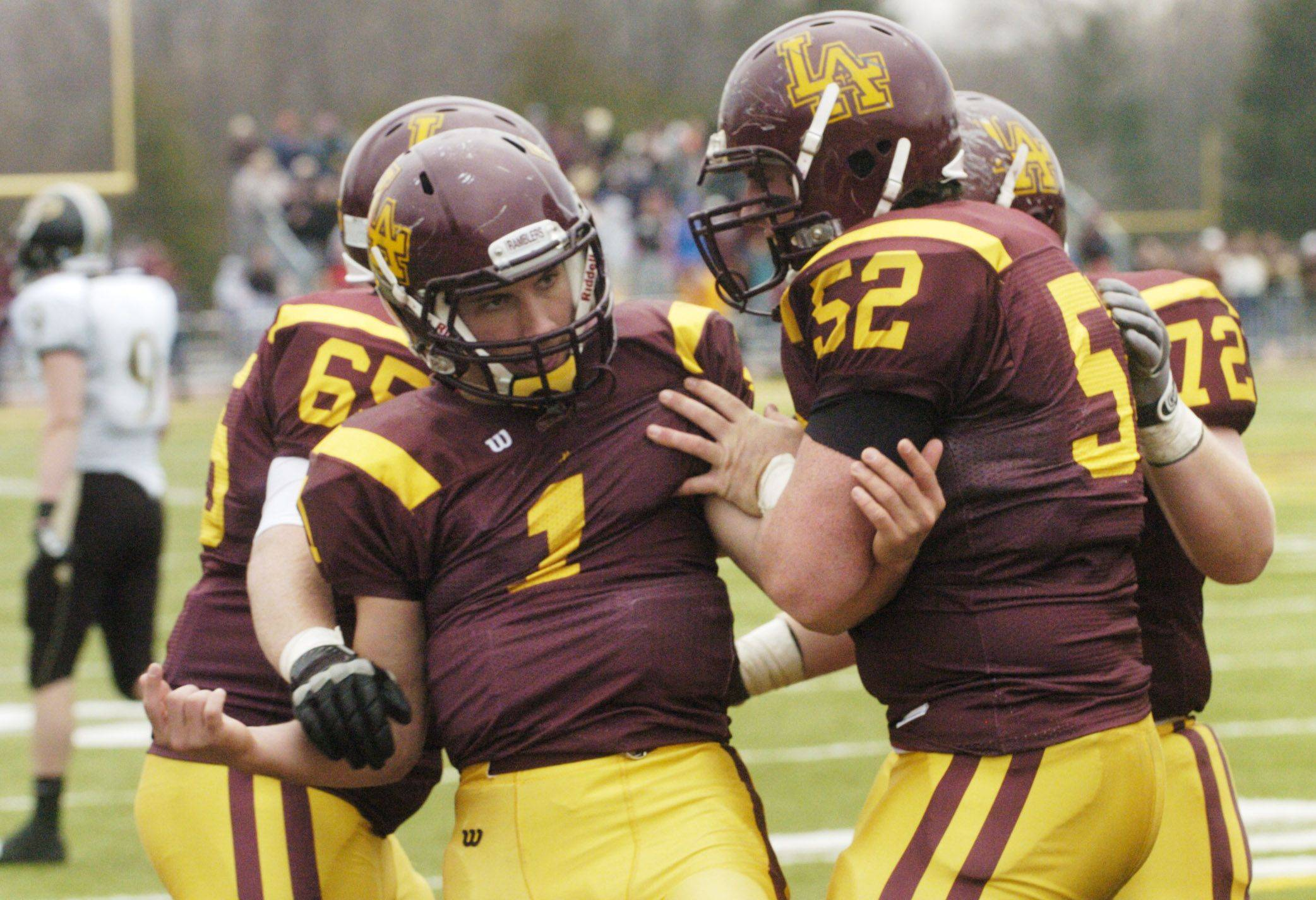 Loyola Academy's William Pavilos, left, celebrates his touchdown with teammate Robert Delaney during Saturday's win against Glenbard North.