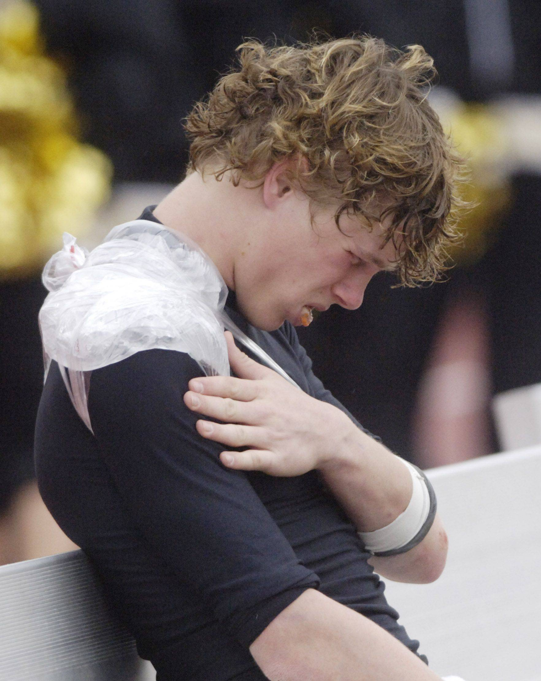 Glenbard North quarterback Brian Murphy sits on the bench with an injured shoulder during Saturday's loss to Loyola Academy.