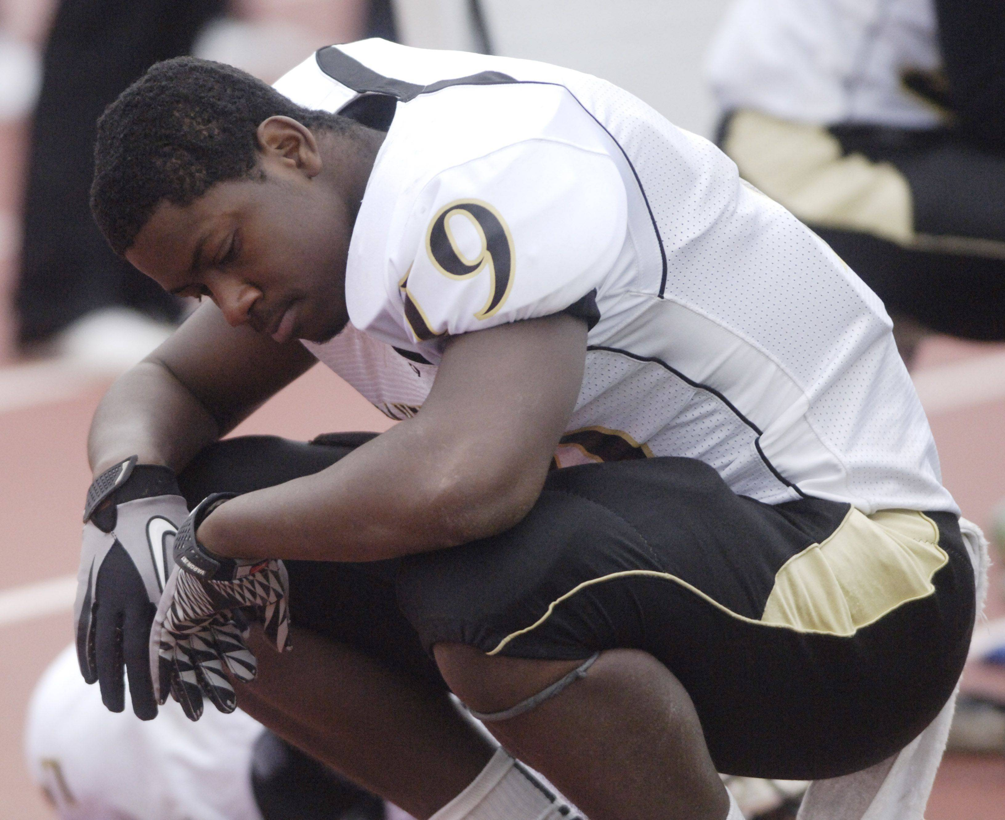 Glenbard North's Marquis Hollins pauses on the sideline during the closing minutes of the fourth quarter during Saturday's loss to Loyola Academy.
