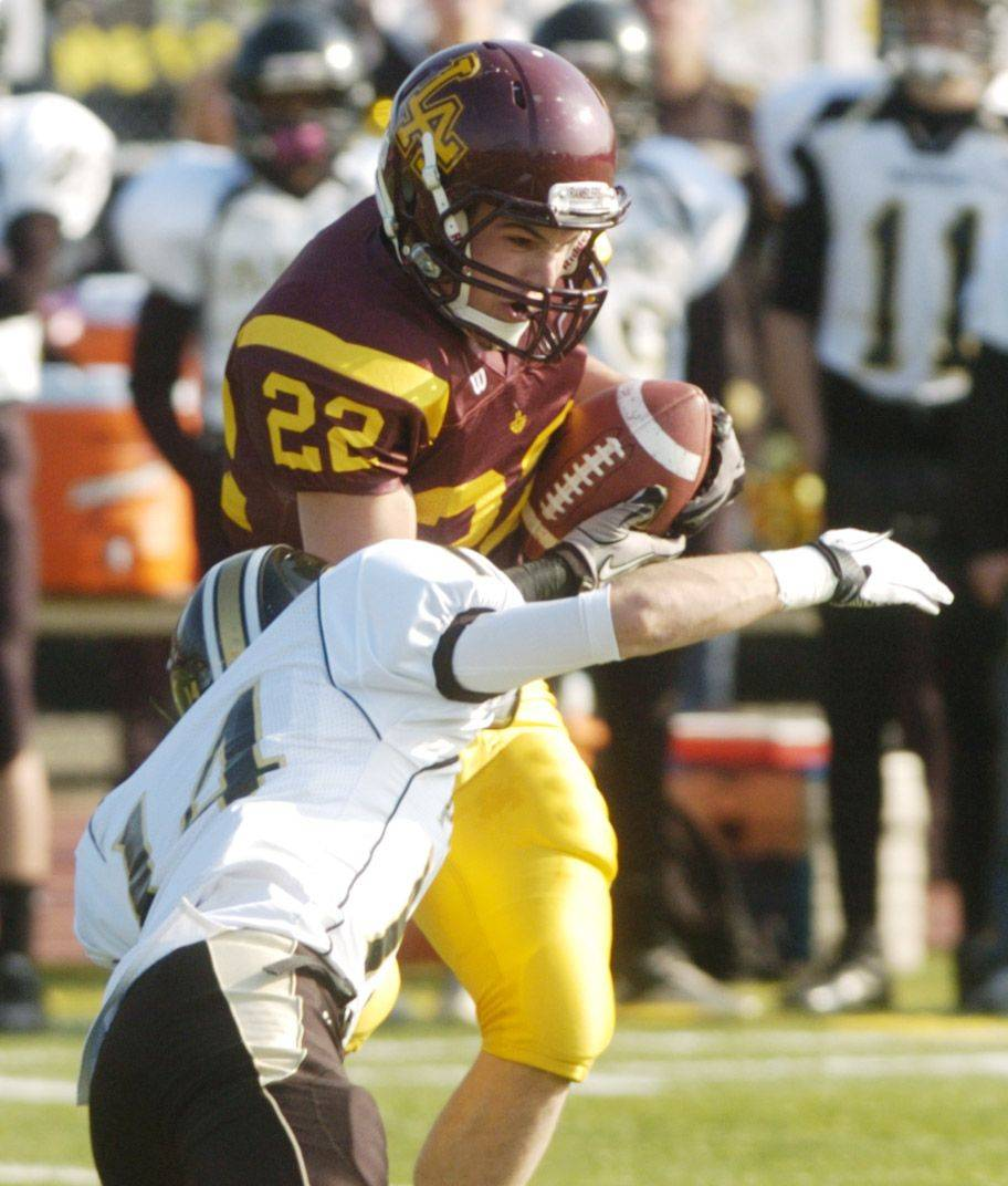 Scotty Suhey of Loyola Academy makes in interception on a pass intended for Ryan Storto of Glenbard North.