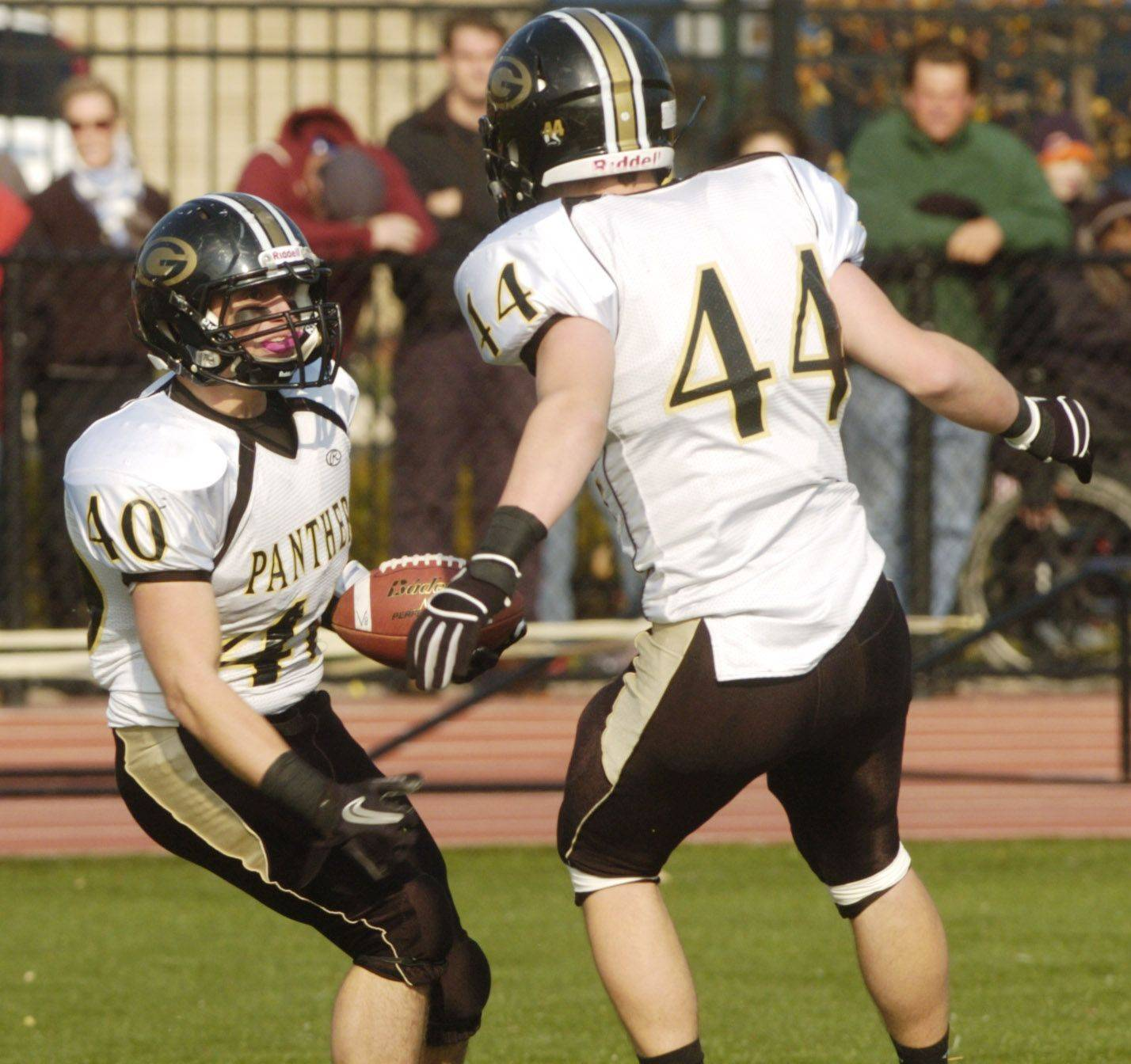 Dominic Fornino of Glenbard North, left, celebrates his touchdown with teammate Andrew Mulshine.