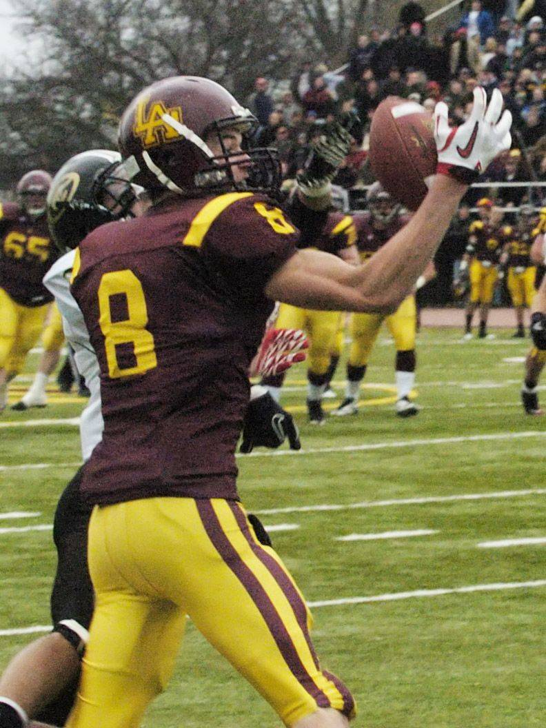 Loyola Academy's Charlie Dowdle makes a catch that went for a touchdown against Glenbard North Saturday.