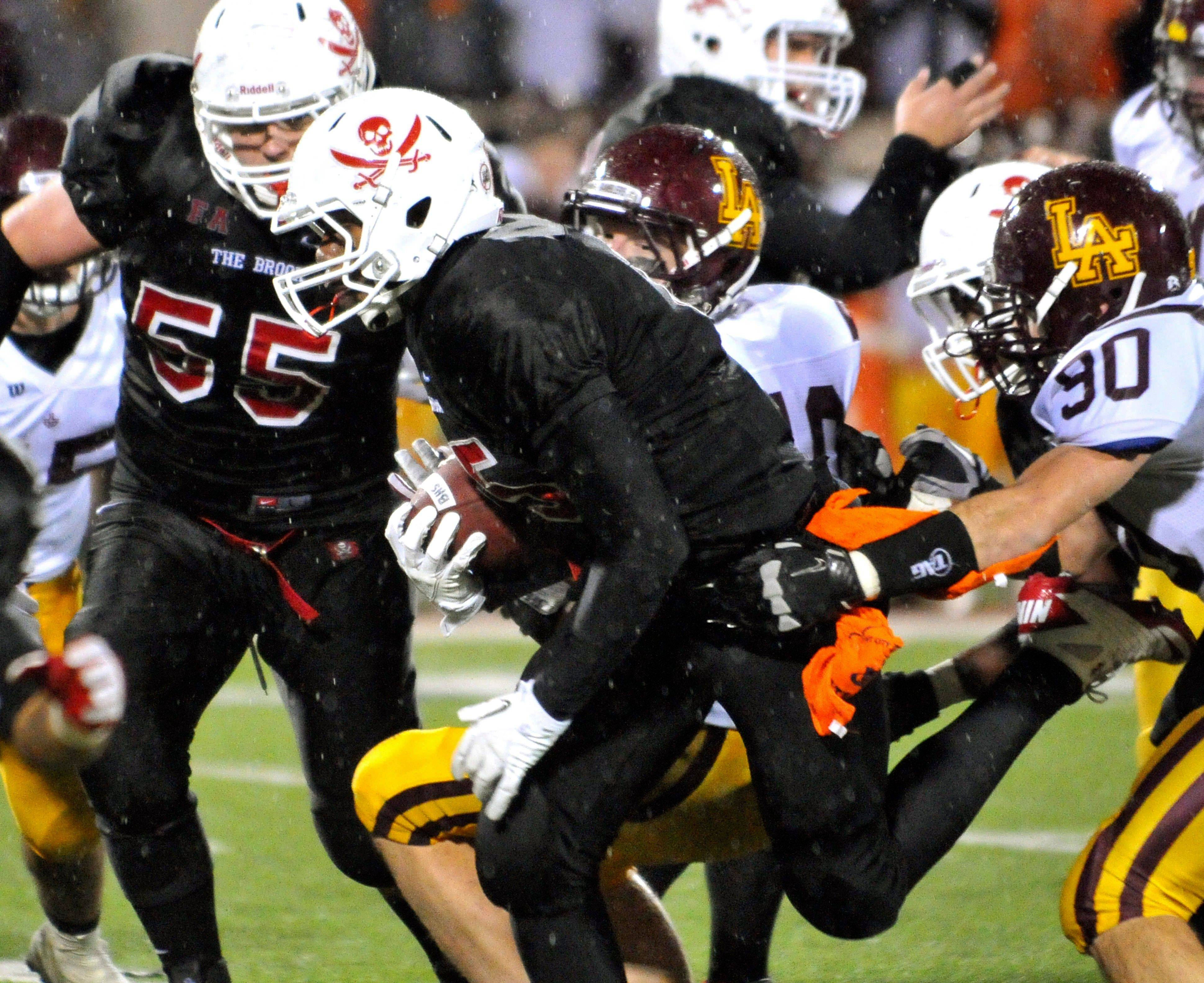 Bolingbrook's Aaron Bailey (15) finds a hole in the Loyola Academy defense for a 33-yard touchdown run.