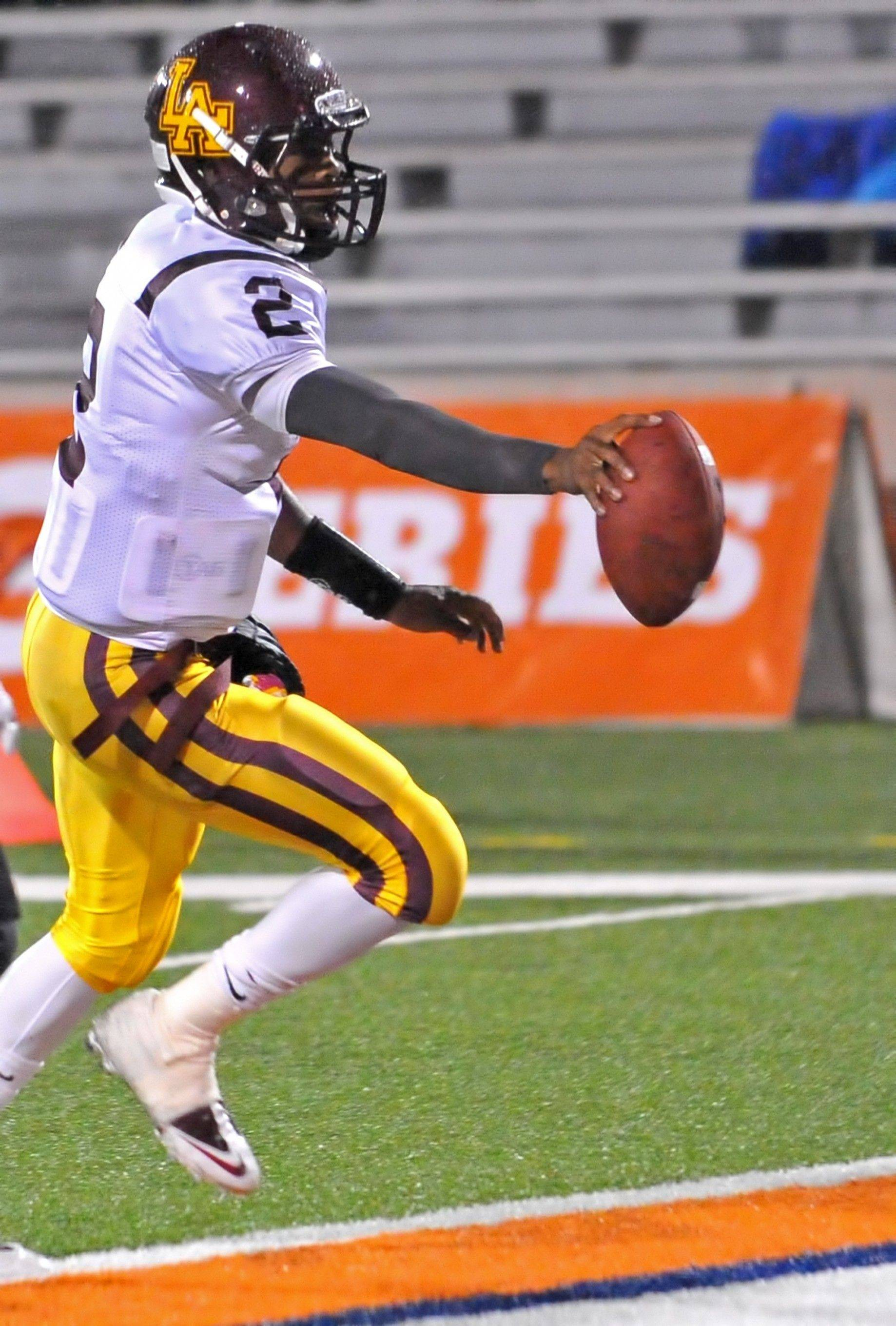 Loyola Academy's Malcom Weaver reaches the end zone against Bolingbrook in the Class 8A championship game Saturday.