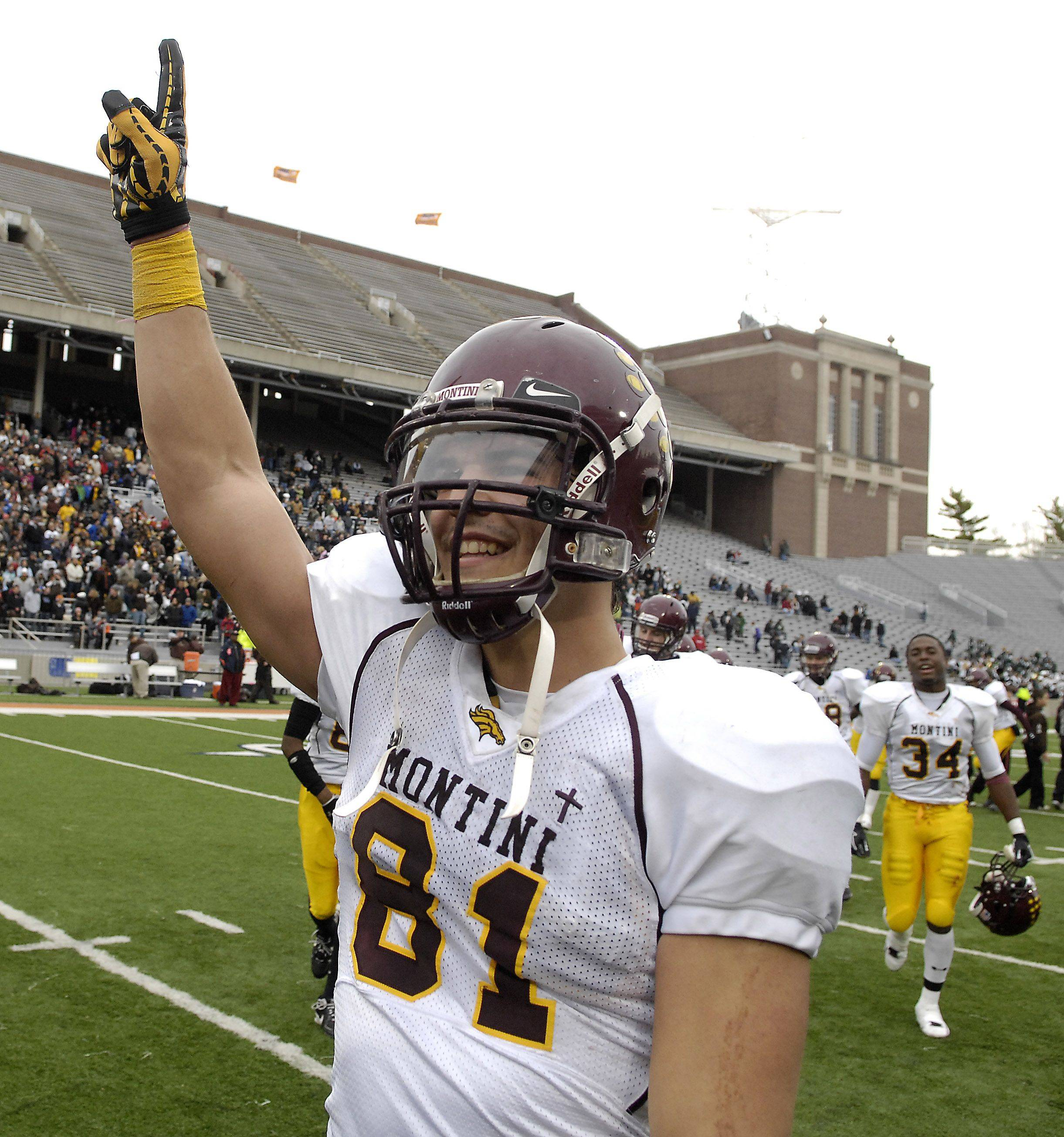 Jordan Westerkamp raises a triumphant hand after he and Montini beat Joliet Catholic 70-45 during the Class 5A state championship in Champaign on Saturday.