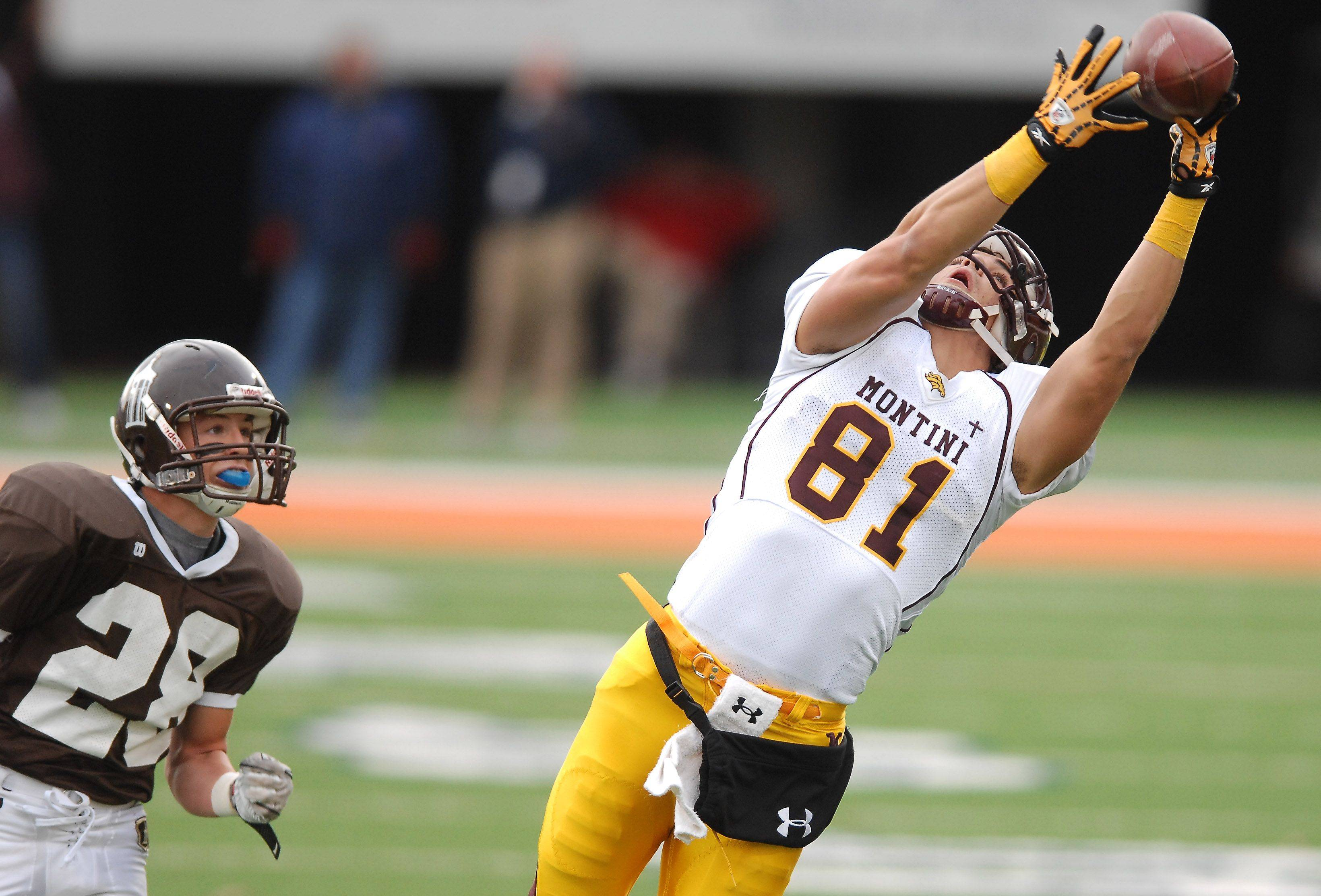 Montini's Jordan Westerkamp hauls in a long pass in front of Joliet Catholic Academy's Grant Harrison during the Class 5A state championship game in Champaign on Saturday.