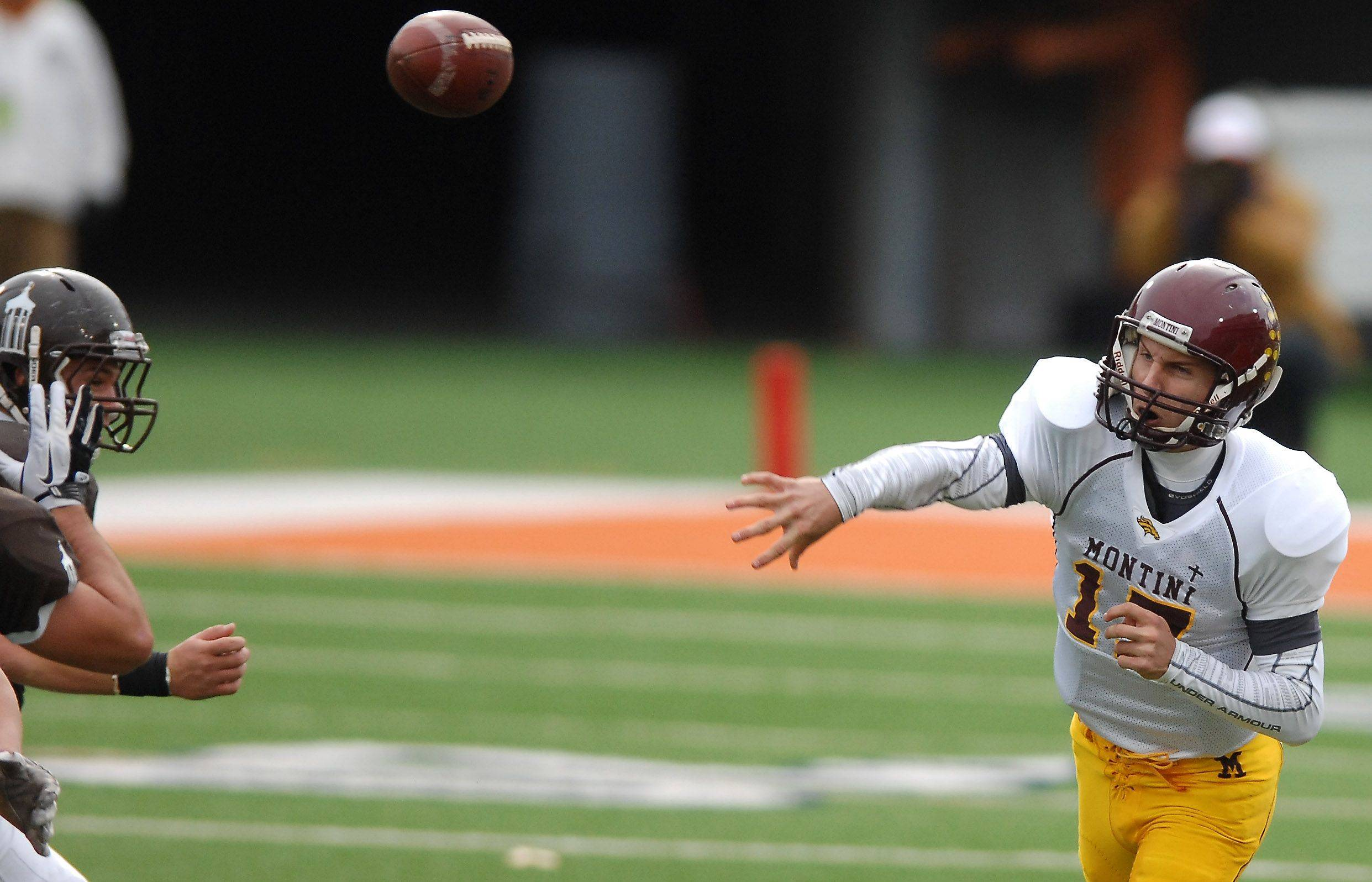 Montini quarterback John Rhode fires a second-half touchdown pass during the Class 5A state championship in Champaign on Saturday.