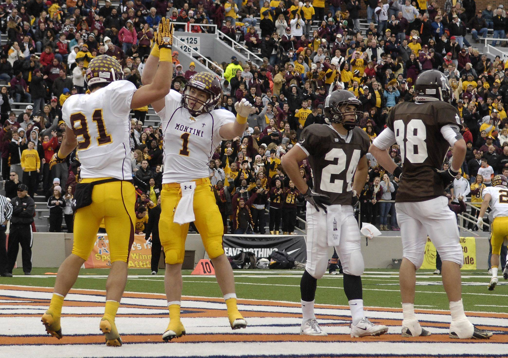 Montini's Jordan Westerkamp (81) and teammate Joseph Borsellino celebrate one of Westerkamp's five touchdown receptions during the Class 5A state championship in Champaign on Saturday.