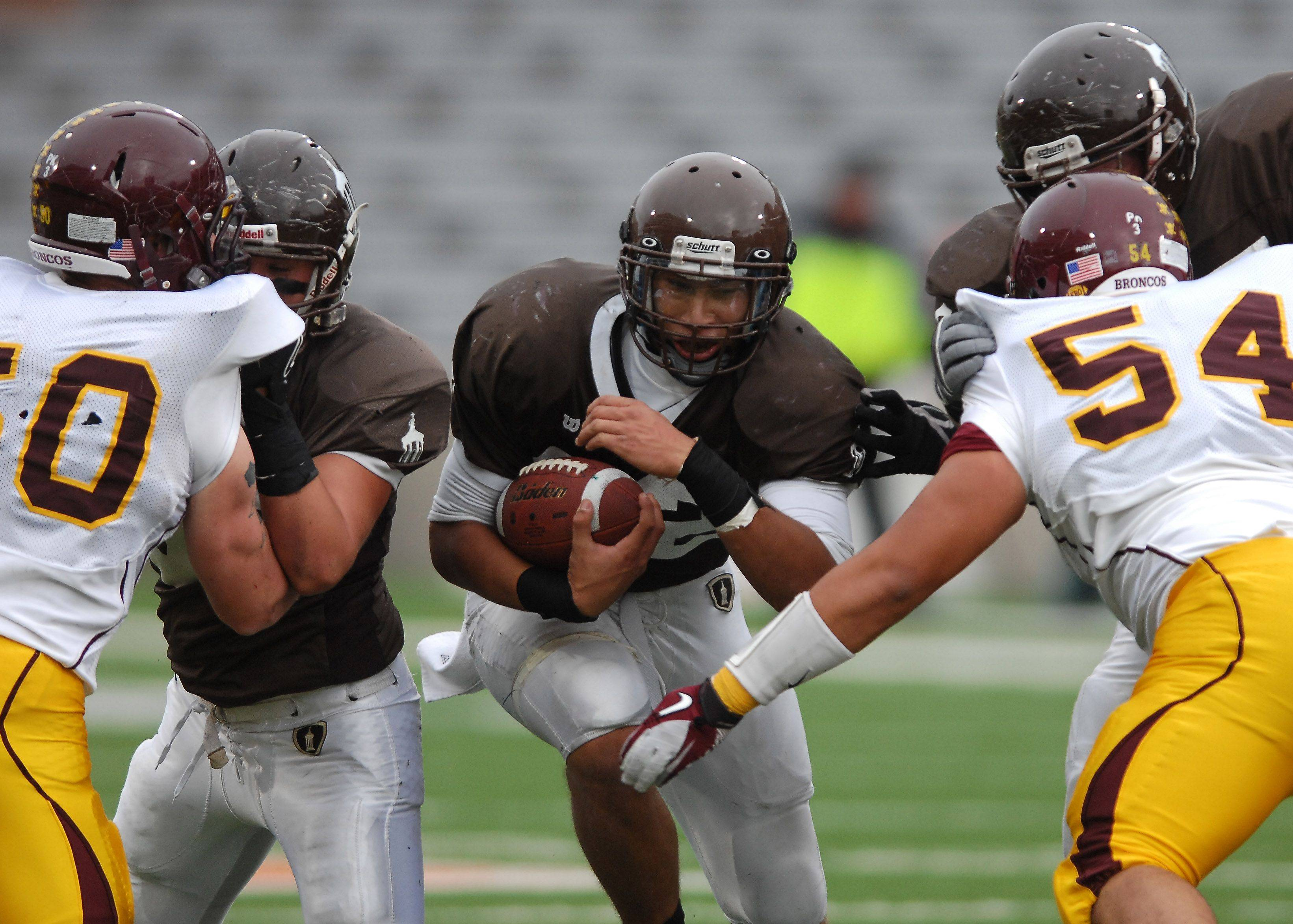 Joliet Catholic's Ty Isaac ran for 515 yards and 6 touchdowns during the Class 5A state championship game against Montini in Champaign on Saturday.