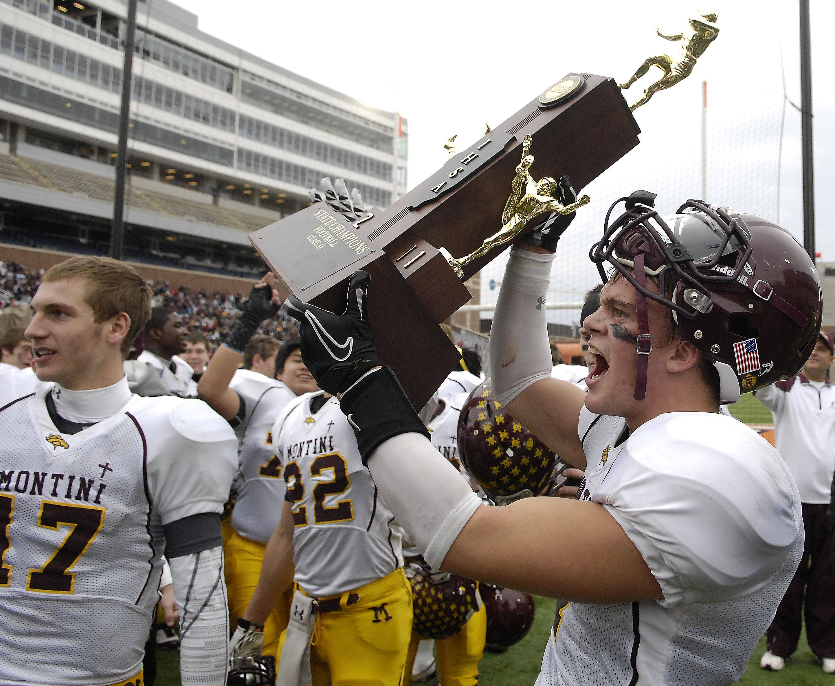 Montini's Tim Mikeworth gets his turn with the trophy following the Broncos' win over Joliet Catholic in the Class 5A state championship in Champaign on Saturday.