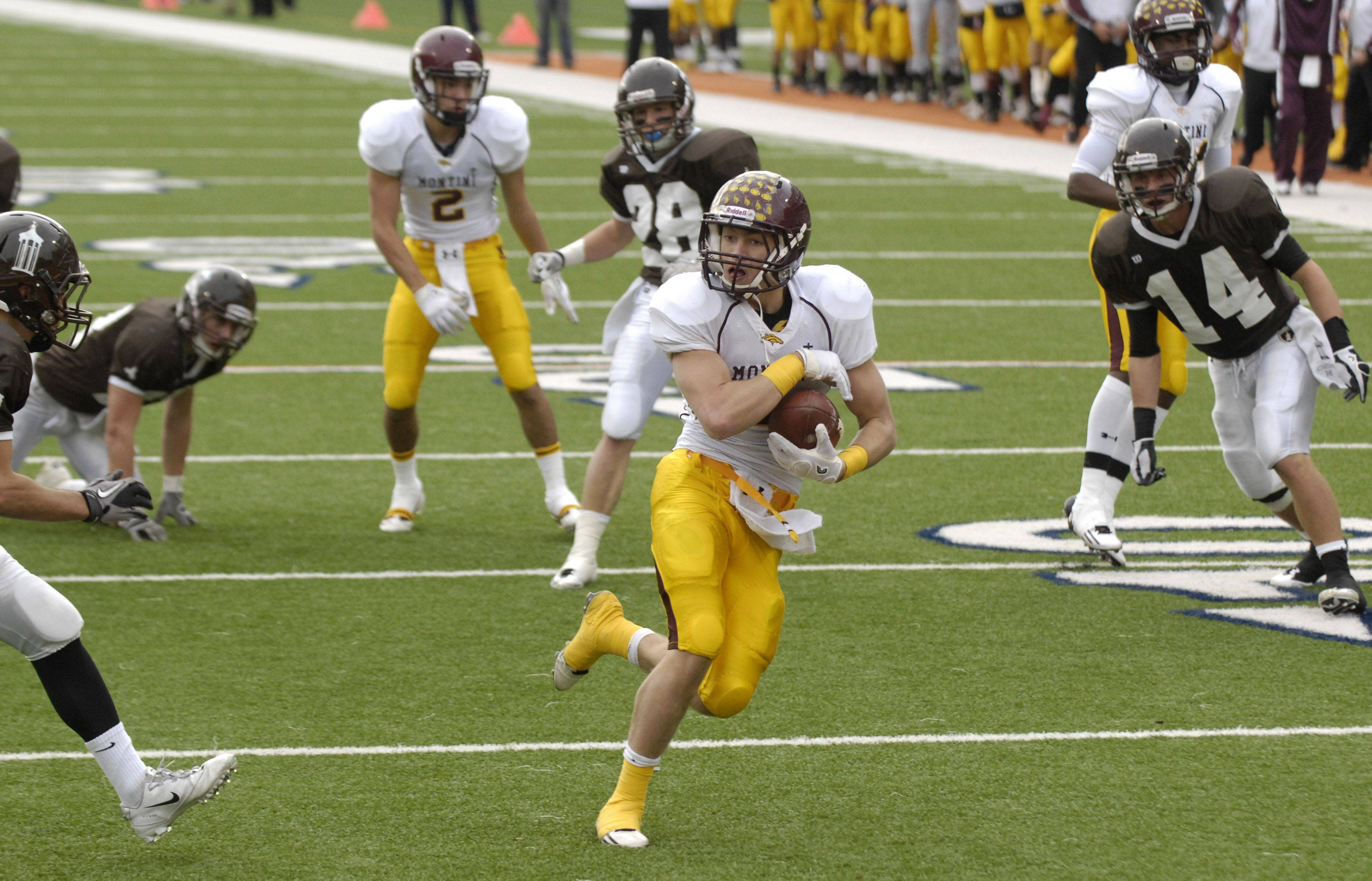 Joseph Borsellino scores Montini's second touchdown during the Class 5A state championship game in Champaign on Saturday.