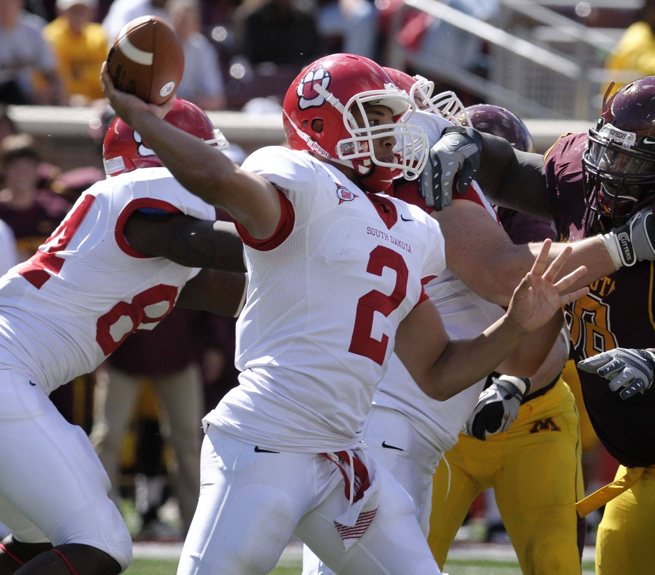 St. Viator graduate Dante Warren, shown here leading South Dakota to an upset of Minnesota in the 2010 season, has been invited to participate in the second annual FCS Senior Scout Bowl on Saturday in Myrtle Beach, S.C.