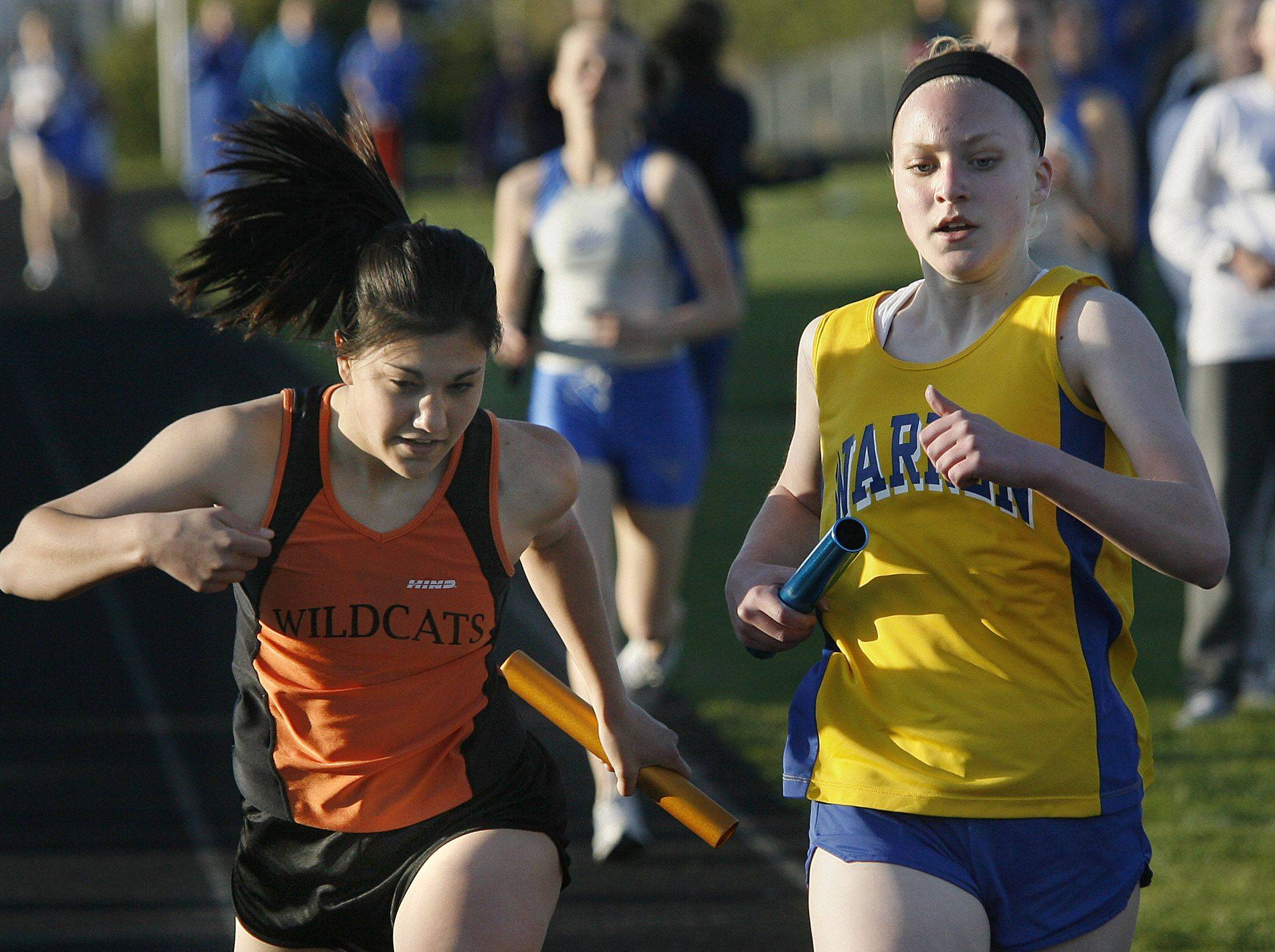 Sarahbeth Jones, at right during her high school days at Warren, earned the Jack Swartz award at Augustana this fall.