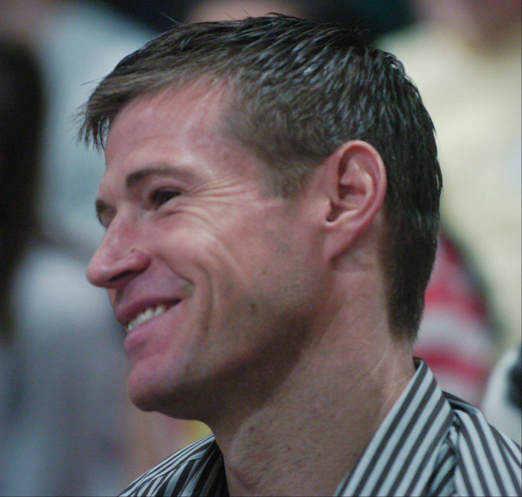 Soccer player Brian McBride watches as he and four other alums who achieved success in professional sports are honored during an assembly at Thomas Middle School in Arlington Heights Thursday.