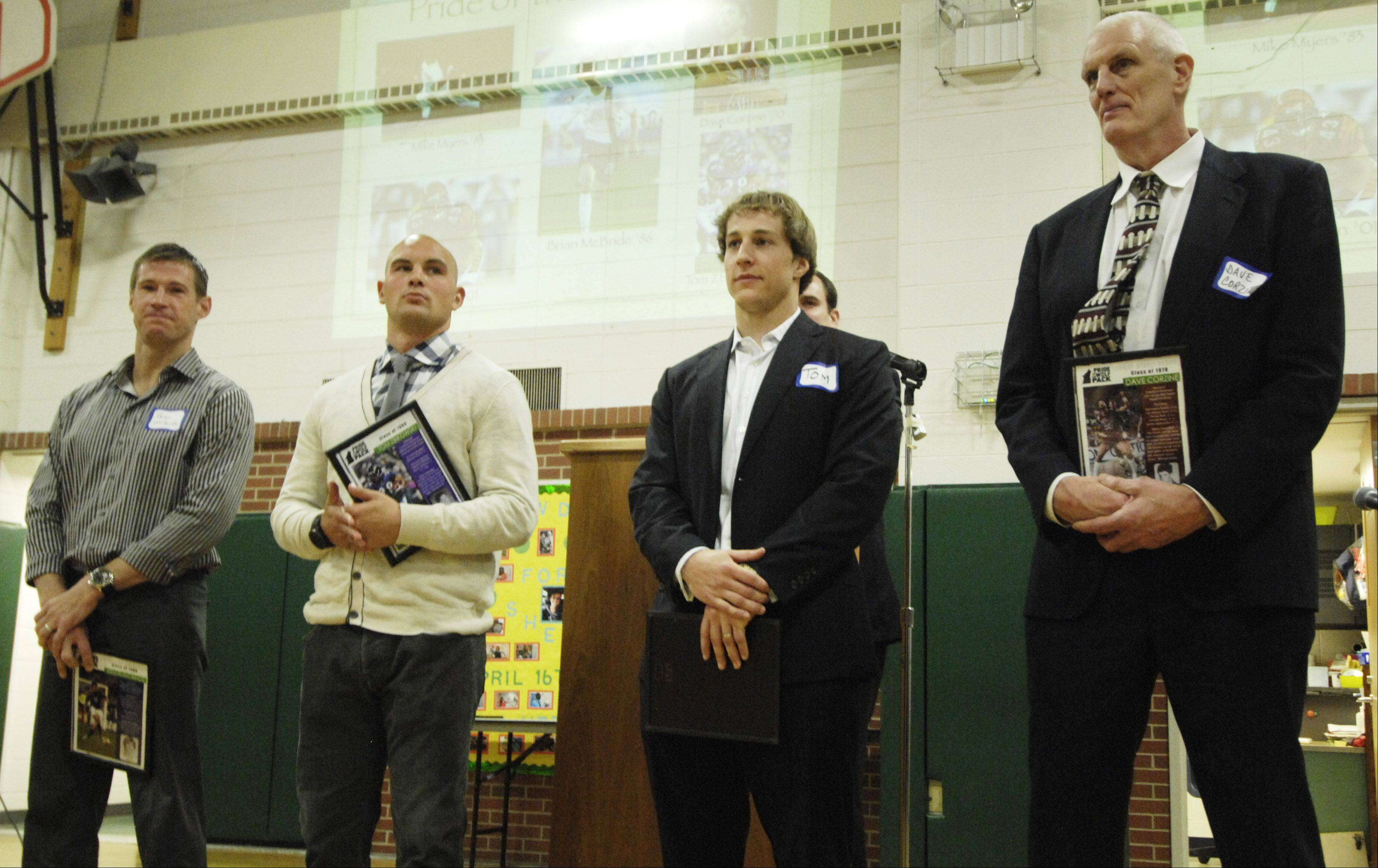 Left to right, Thomas Middle School alums Brian McBride, Tom Zbikowski, Tom Nelson and Dave Corzine stand together as they are honored for their athletic success during an assembly at the Arlington Heights school Thursday. Baseball standout Mike Myers was also honored but was unable to attend.