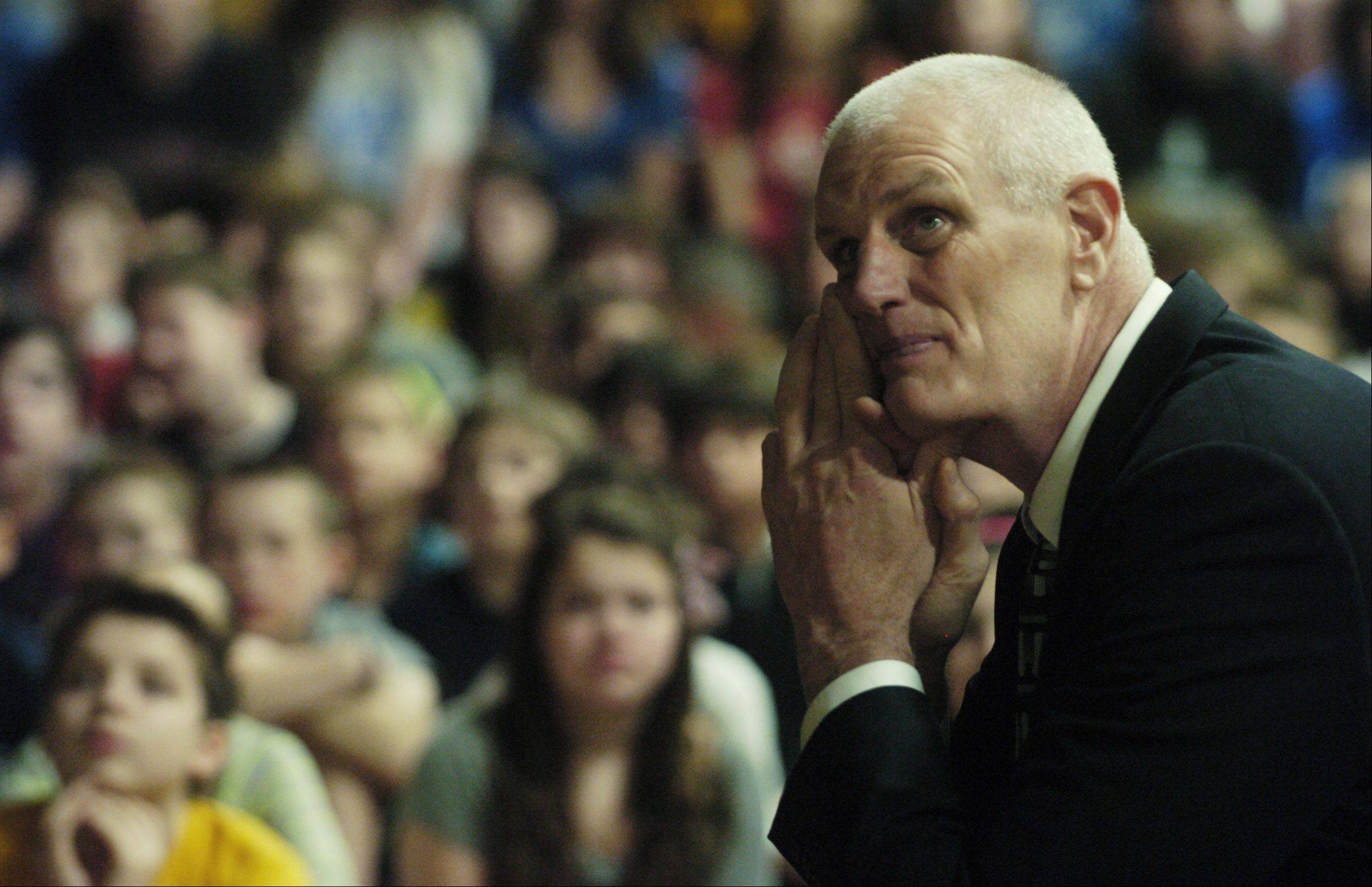 Dave Corzine watches a video clip during an assembly at Thomas Middle School in Arlington Heights on Thursday.