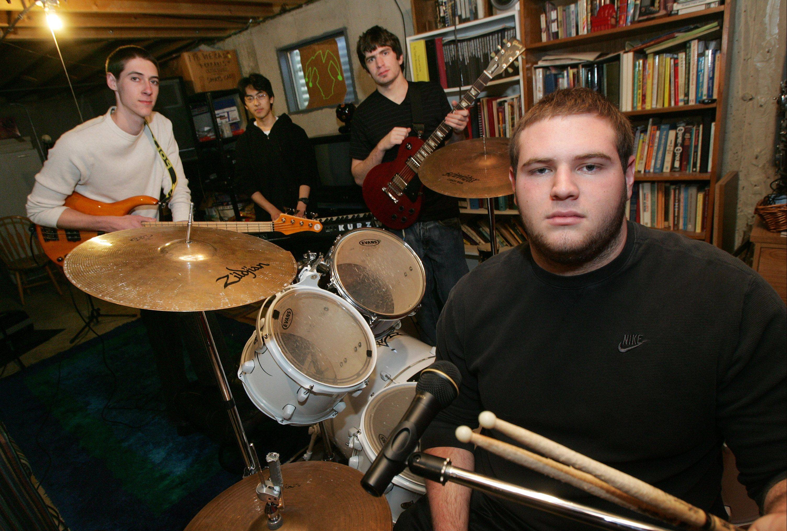 "Stevenson football player Brad Meyer plays drums with his band ""Foolish"" that includes Donald Bender on lead guitar, Kai Funahashi on keyboards and Jordan Gates on bass guitar. Here, they're practicing in Meyer's basement Thursday. The band was voted No. 1 at Stevenson and plans to release its album ""The Last Laugh"" on iTunes on May 4."