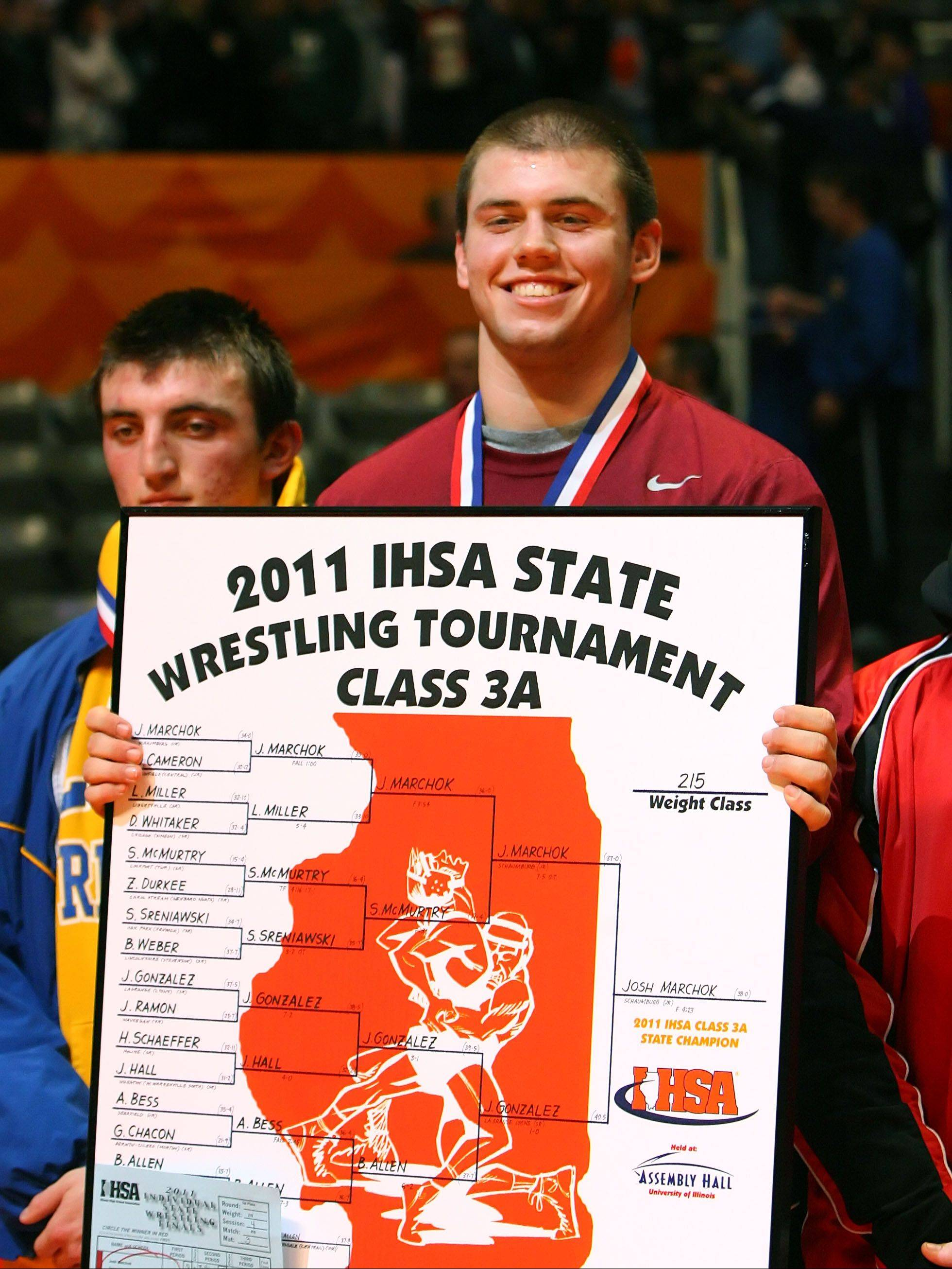 Schaumburg's Josh Marchok holds up the 215-pound championship bracket following his 2011 title in Champaign.
