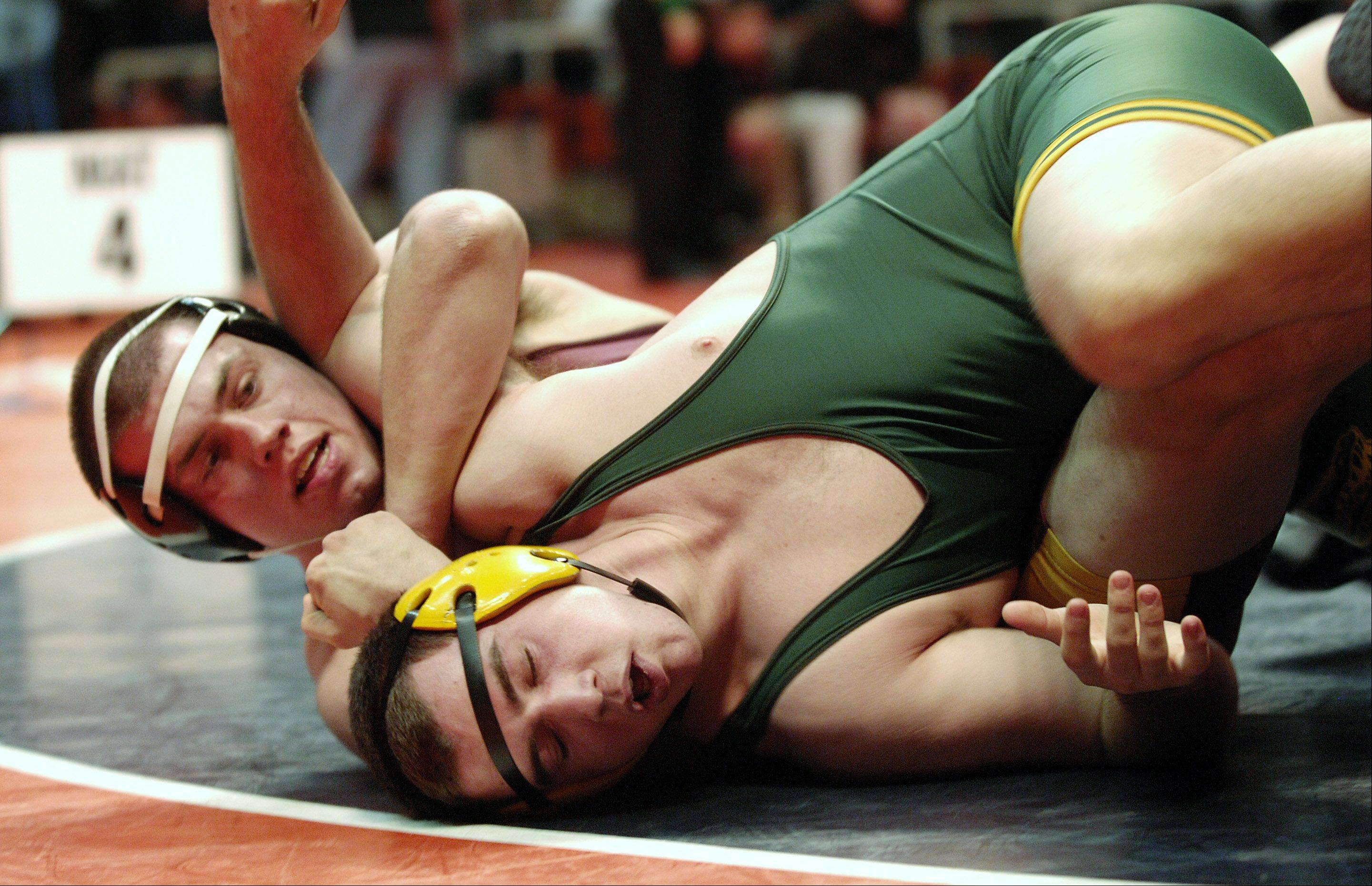 Josh Marchok of Schaumburg, left, wrestles and defeats Mike Romanelli of Crystal Lake South during a 3A 220 quarterfinal bout at the 2012 IHSA wrestling state finals in Champaign.